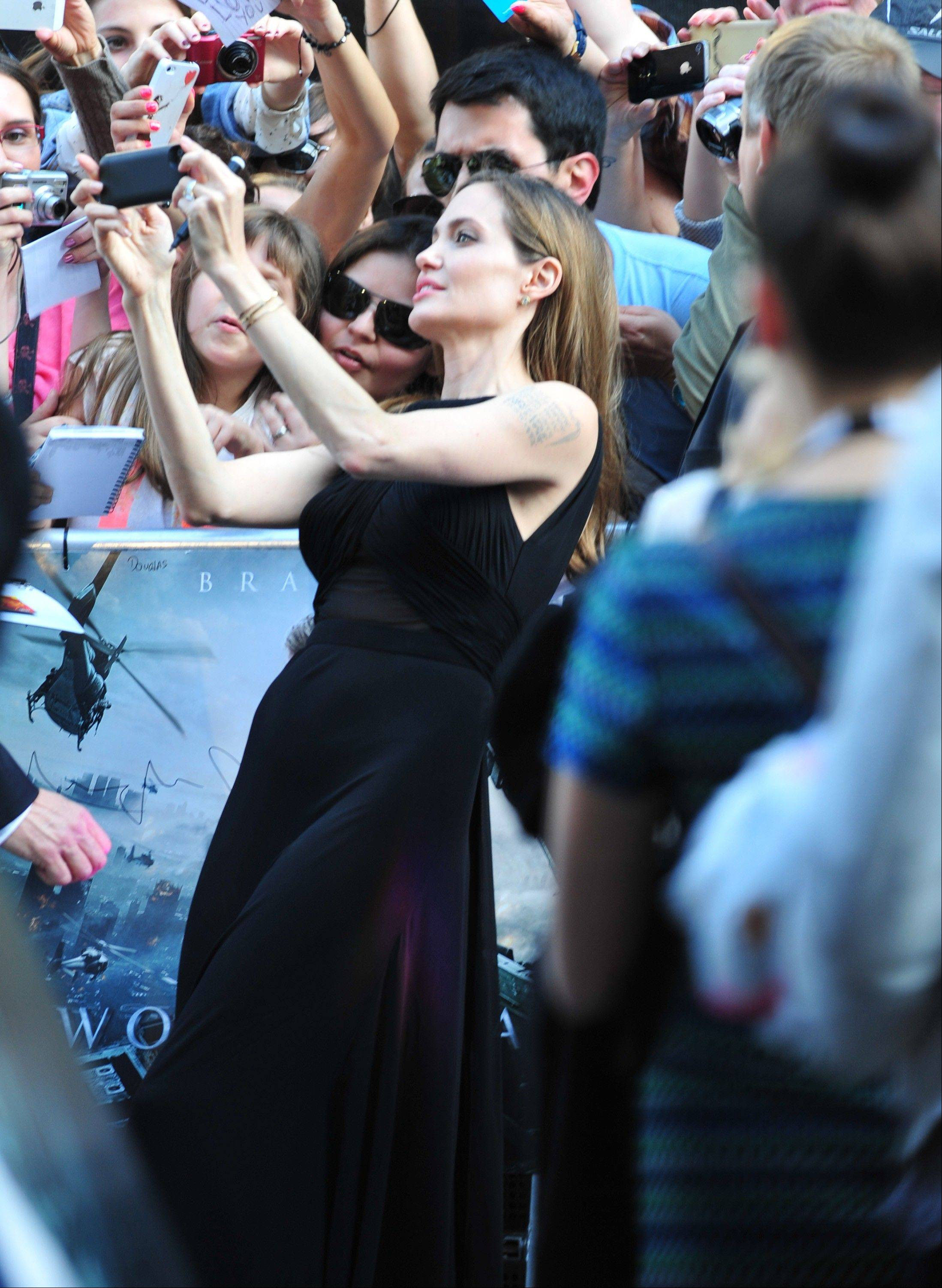 Angelina Jolie greets fans at the World Premiere of 'World War Z' at the Empire Cinema in London on Sunday June 2, 2013.