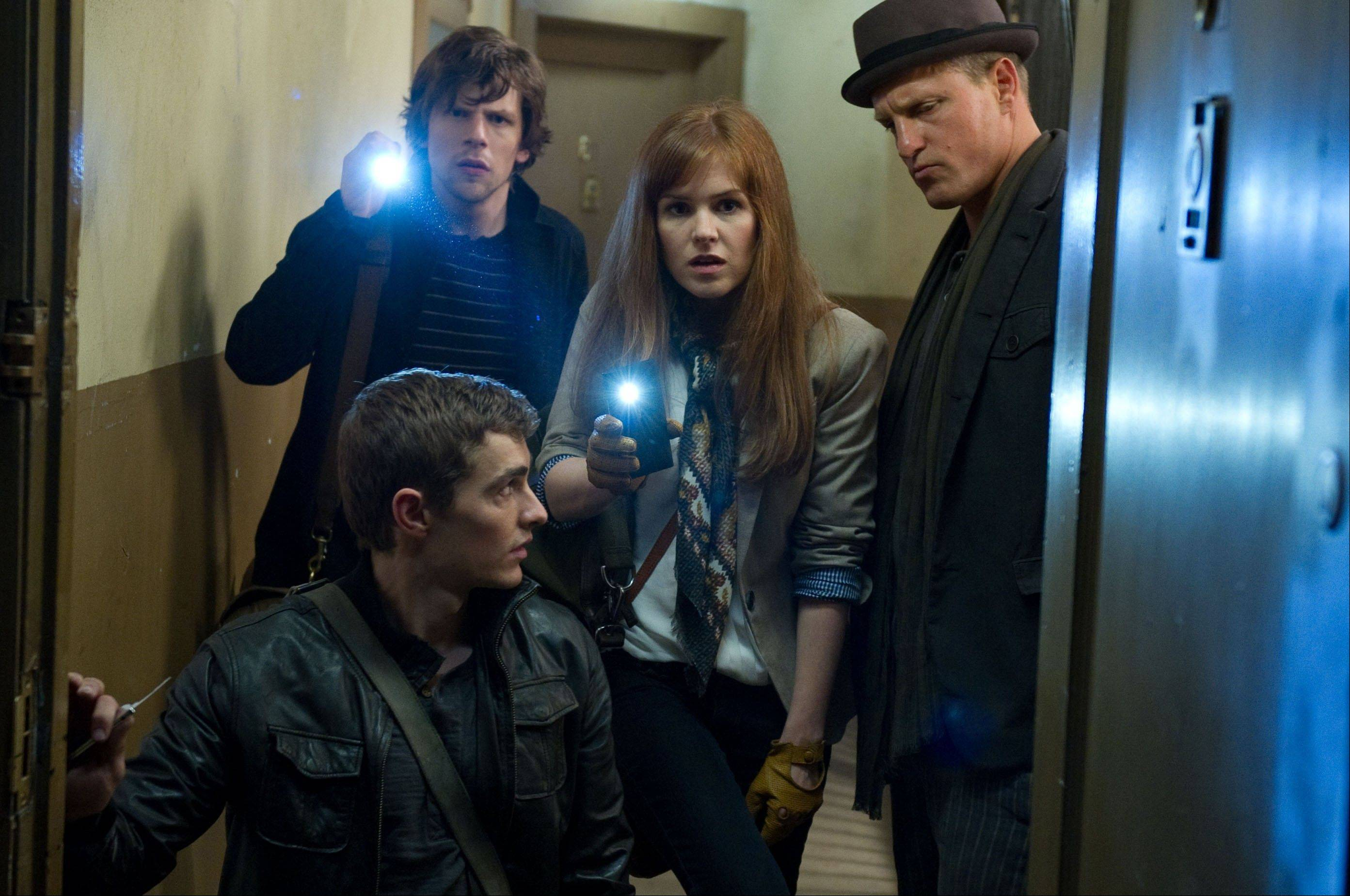 "Four professional magicians (Dave Franco, Jesse Eisenberg, Isla Fisher and Woody Harrelson) get involved in a Robin Hood-like conspiracy of revenge in ""Now You See Me."" The magic-heist thriller exceeded industry expectations to debut in second place with $28.1 million."