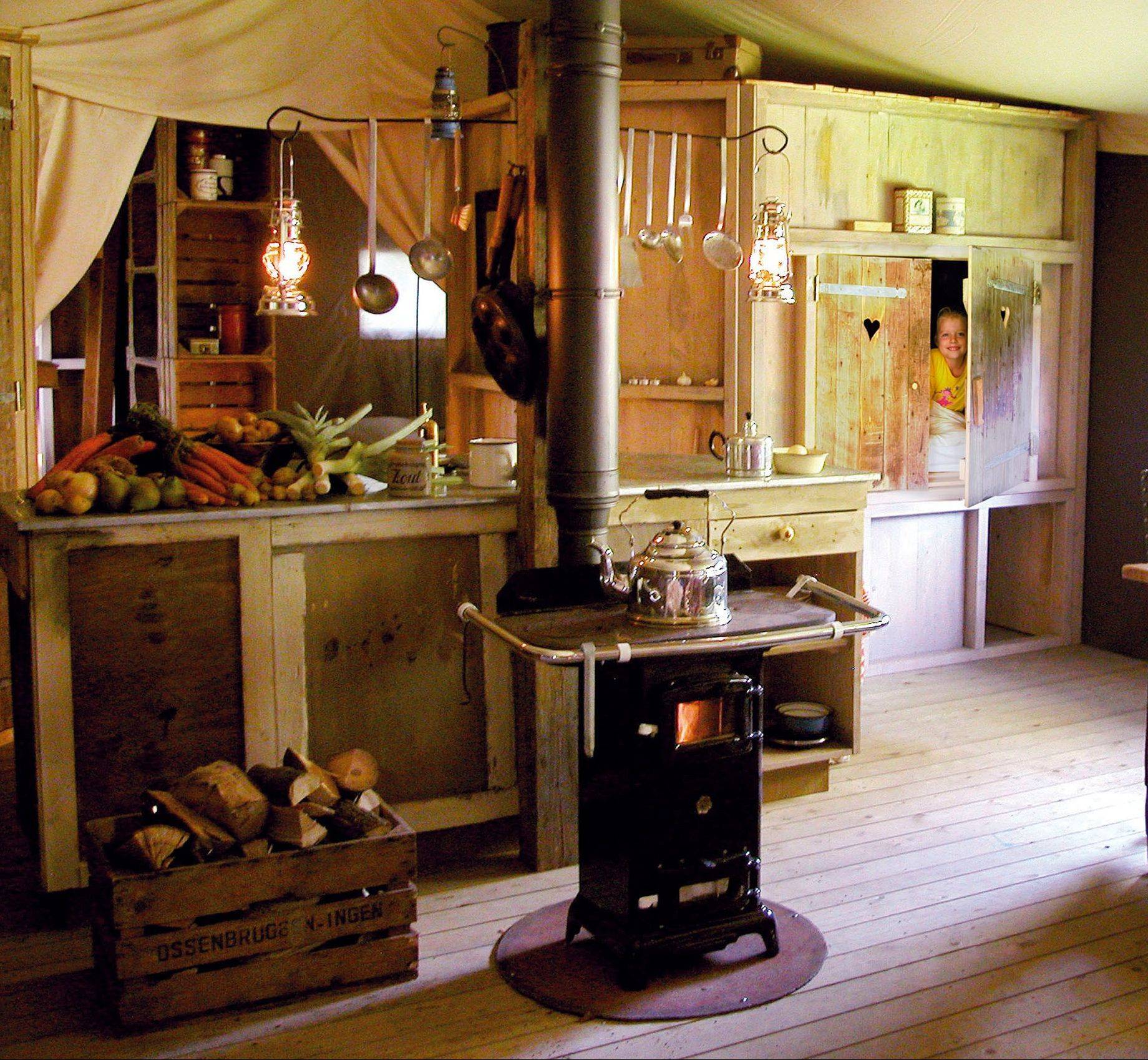 "Feather Down Farm Days offers a ""Farm Days Tent"" for visitors to stay in, which includes a cooking stove and cupboard bed, right."