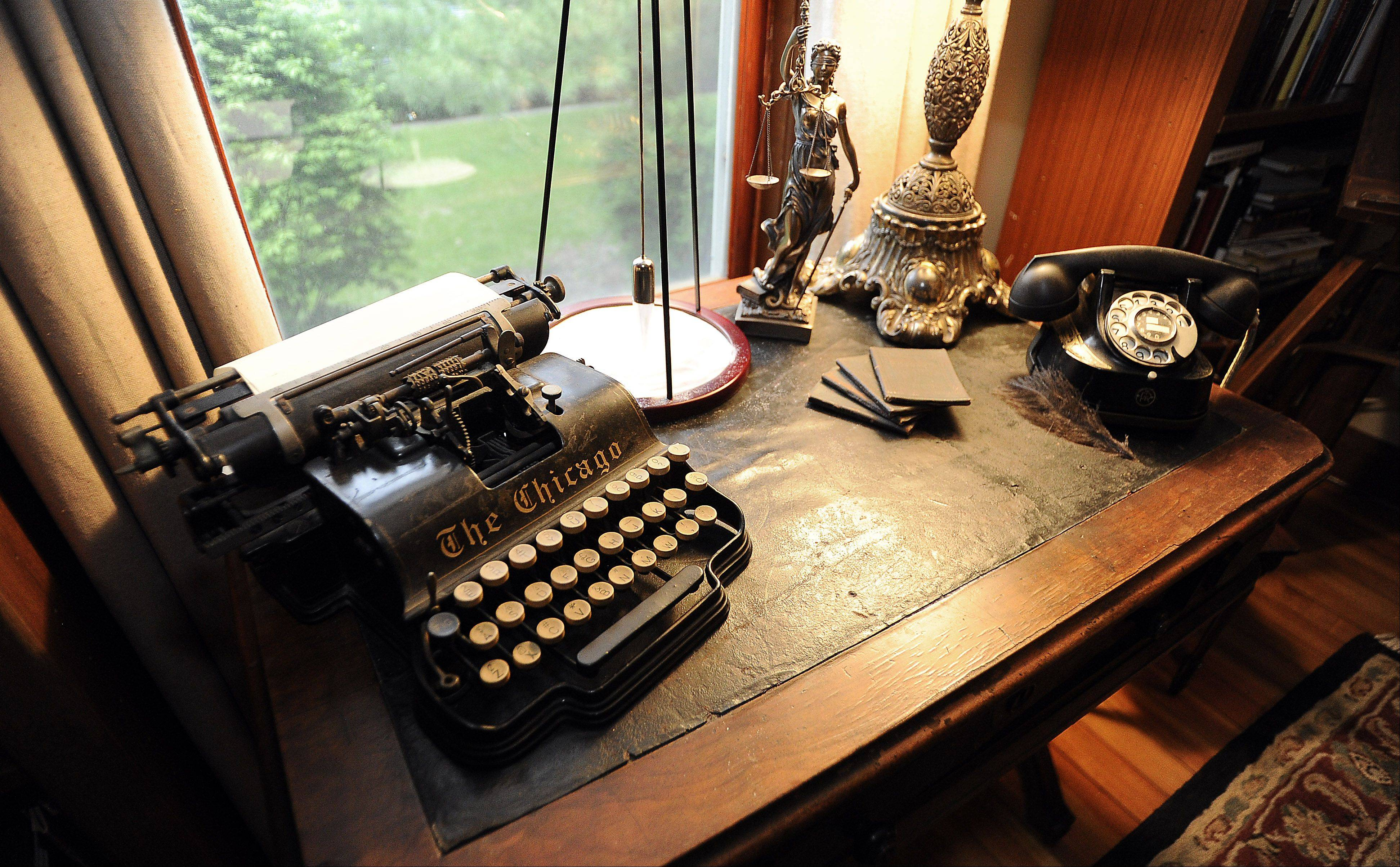 The Chicago, a typewriter about the same age as the house, and a rotary telephone from a Belgian hotel decorate the library in Laurie Turpin-Soderholm and Rob Soderholm's home.