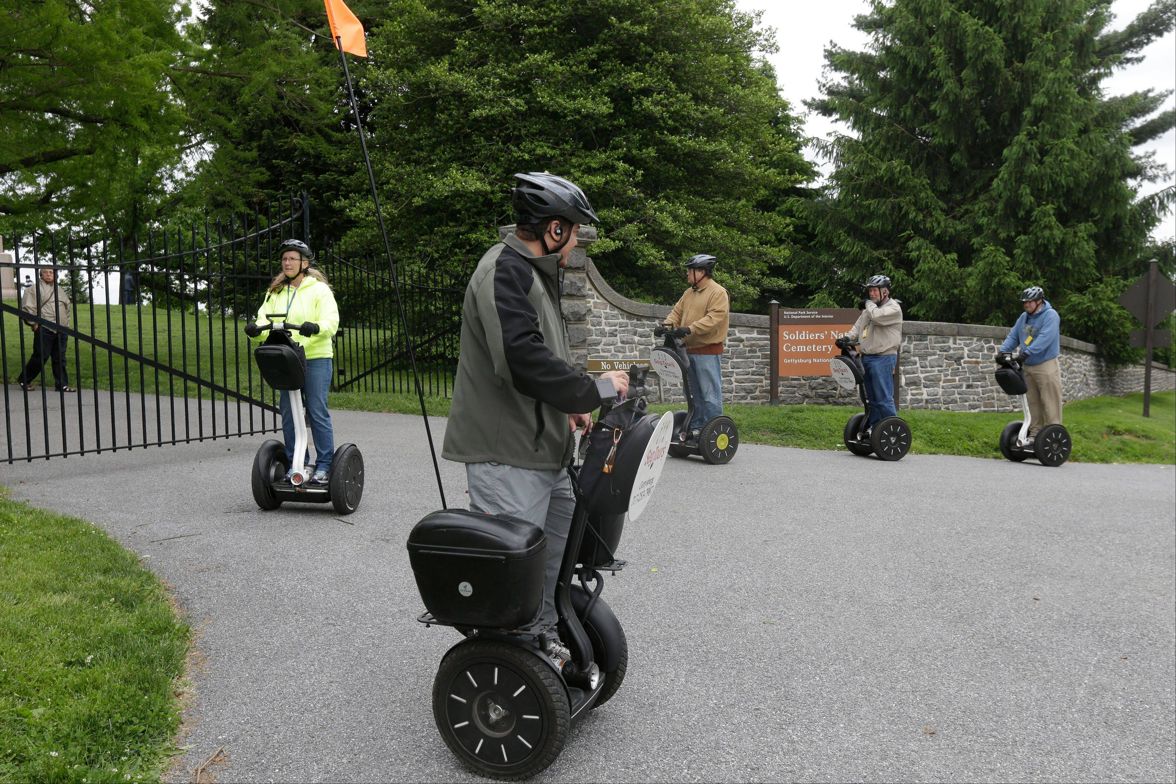 Visitors riding Segways tour Gettysburg National Military Park.