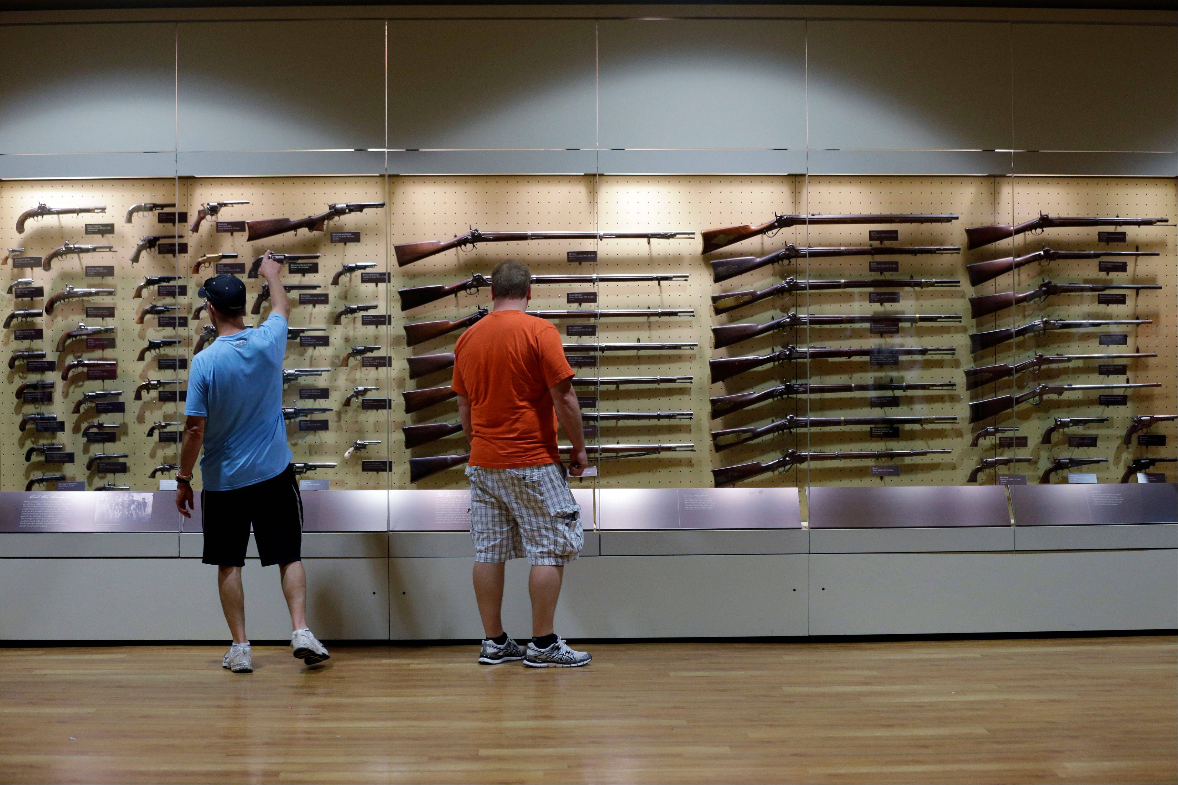 Tourists view Civil War weapons at the Gettysburg National Military Park, Museum & Visitor Center.