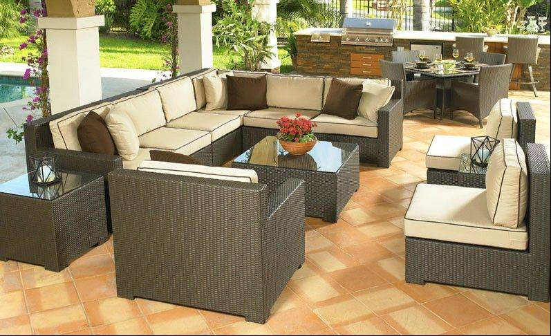 This set up, called Malibu, by North Cape International, would be great for outdoor use all year long. It is made of synthetic wicker so it will not rust and it boasts a great setup for entertaining large groups.