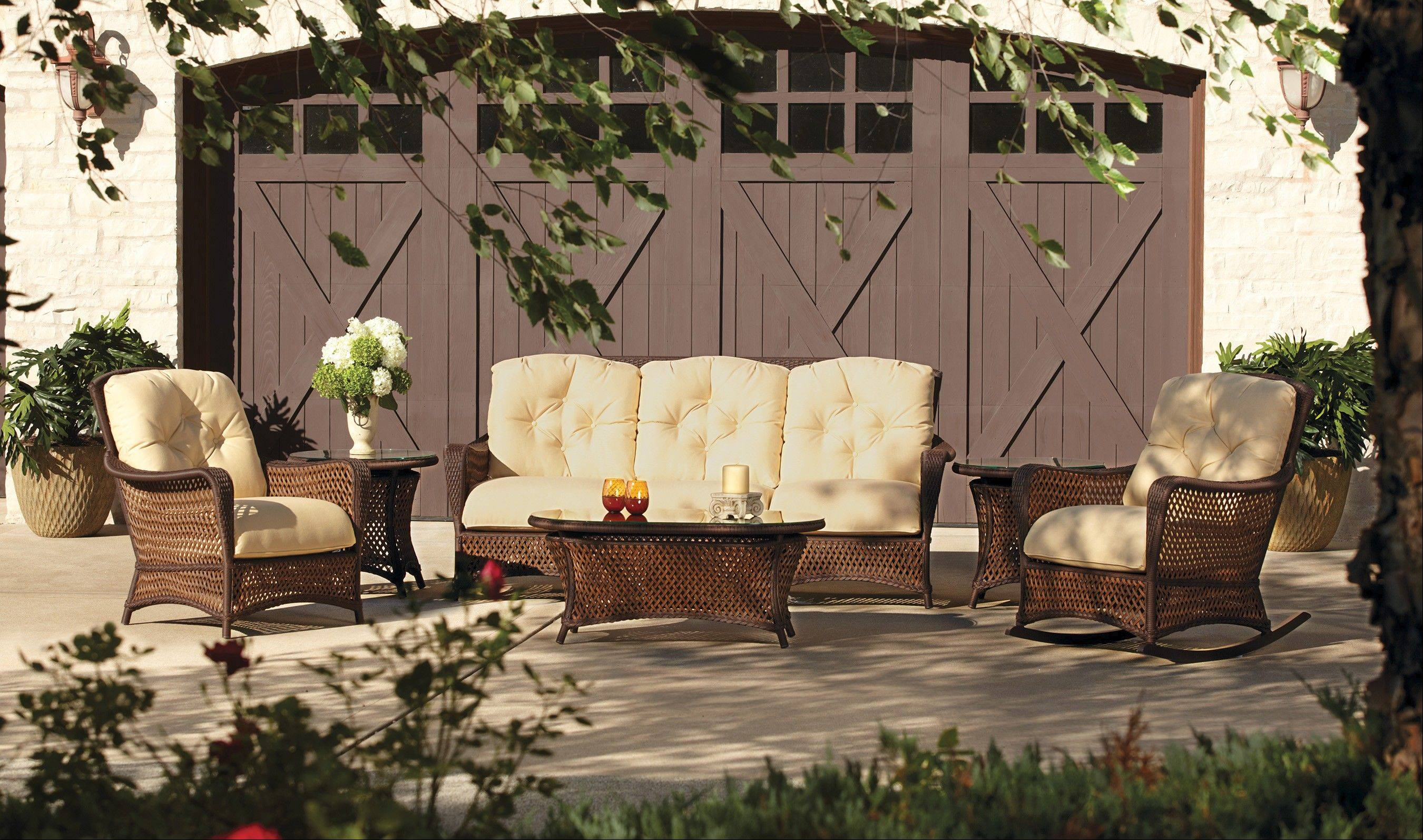 A Lloyd Flanders set could provide a seating area with sofa and a love seat with two lounge chairs around the pond with dining behind it in all-weather vinyl wicker with aluminum frame and cushions.