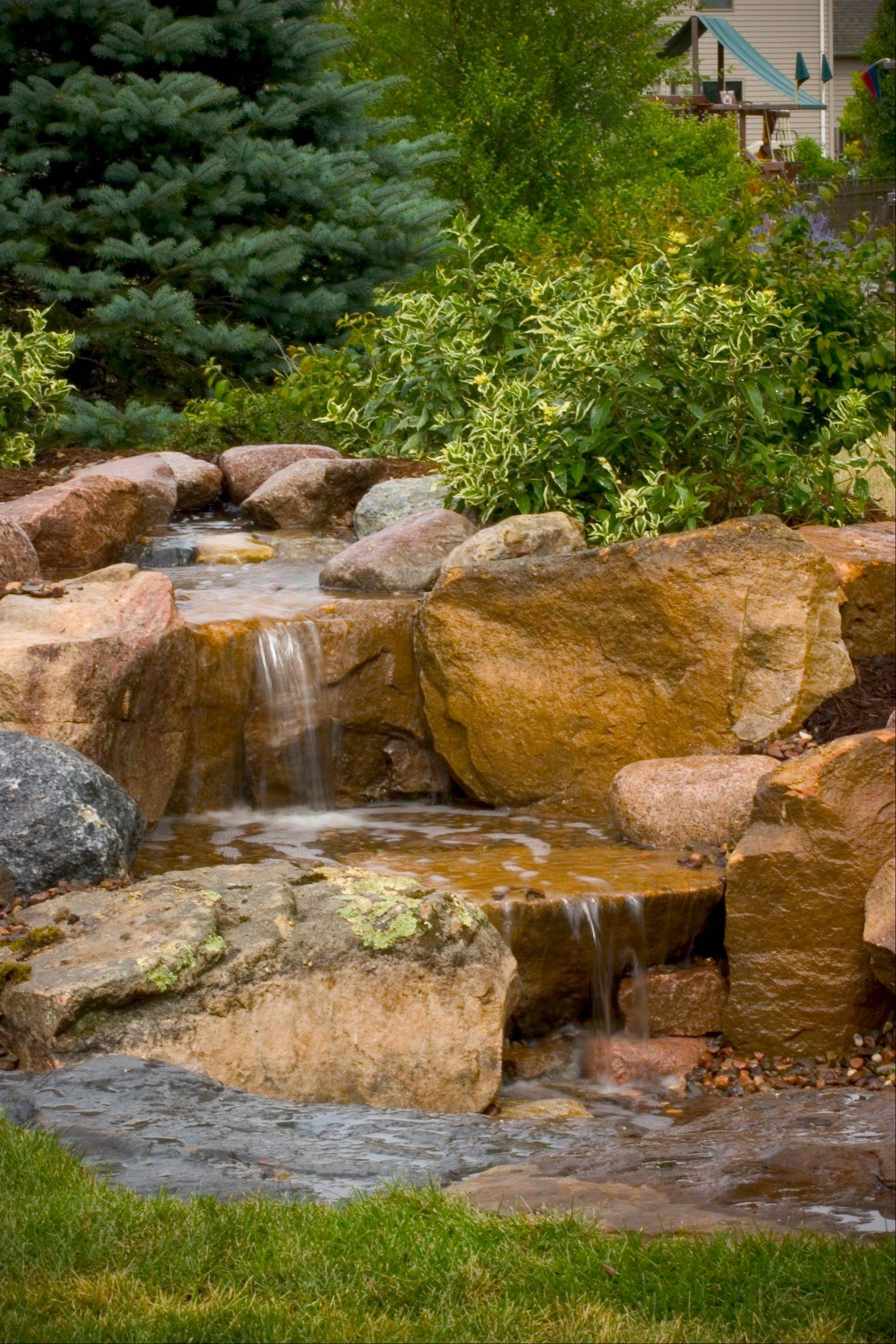 A waterfall would help this family realize their dream backyard.