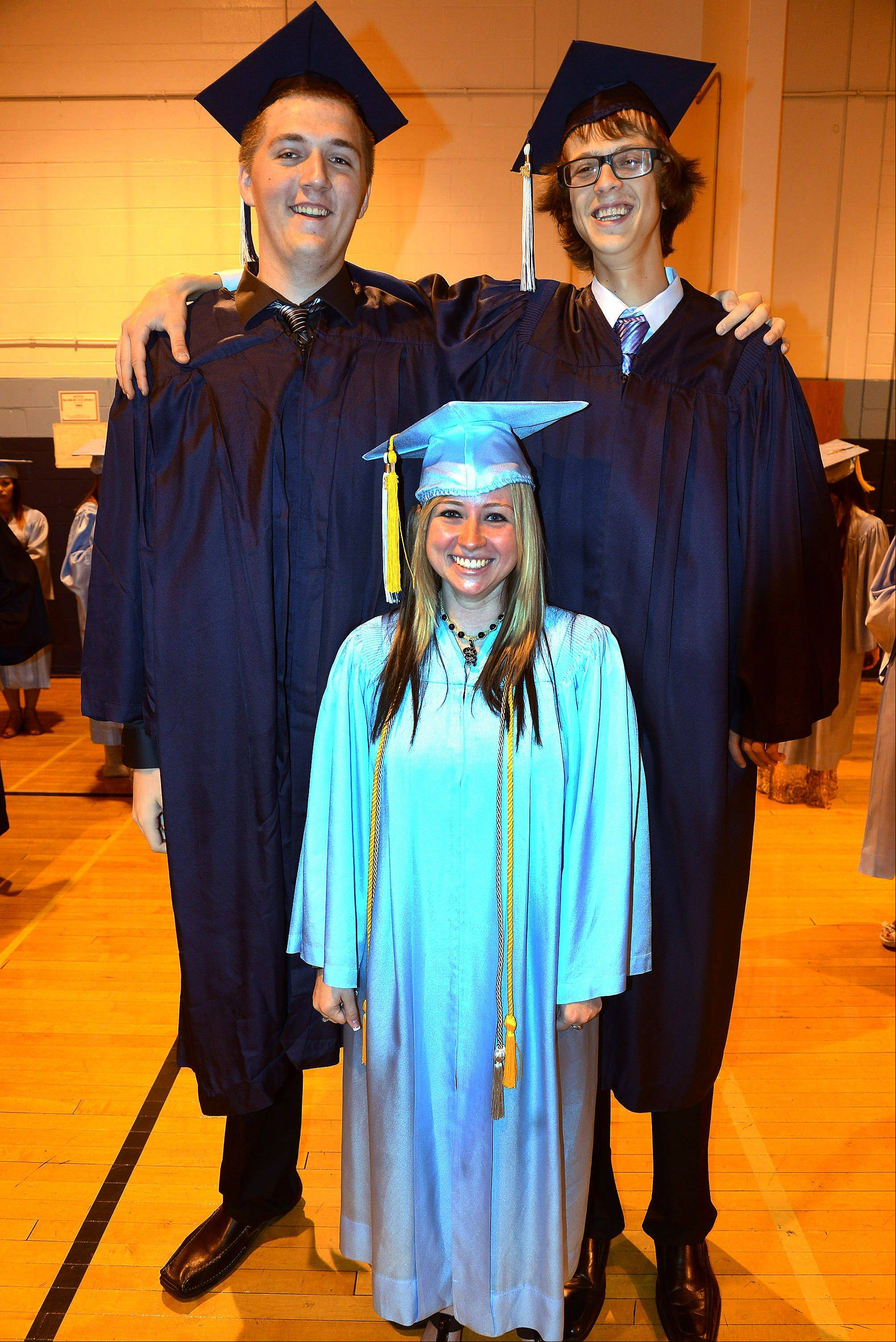 7-foot-1-inch Chris Huene, left, and 6-foot-9-inch Chris Drozd, dwarf 5-foot Annie Potts as they pose for a picture before the Prospect High School graduation.