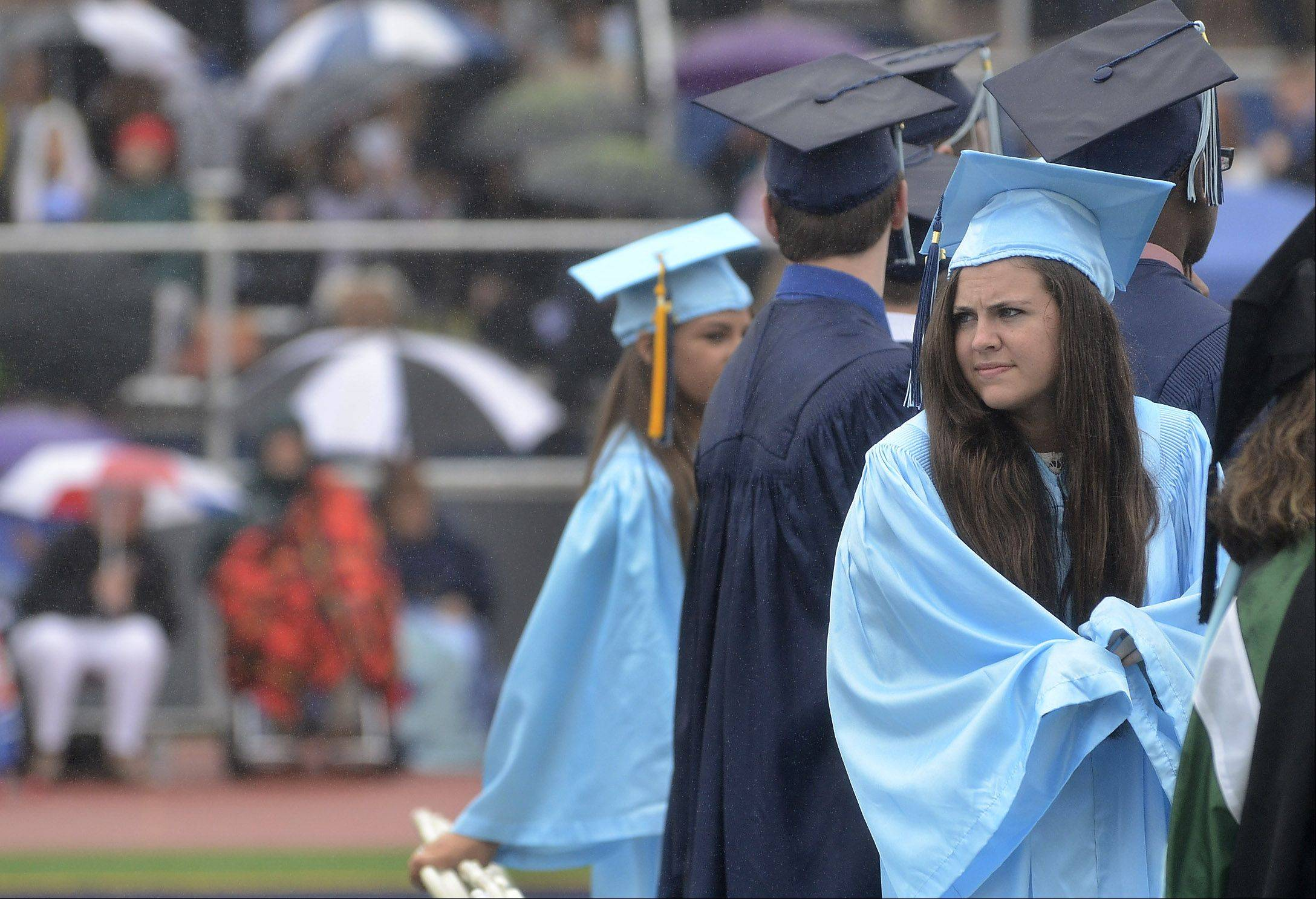Dawn Grimm, right, weathers the rain during the Prospect High School graduation.