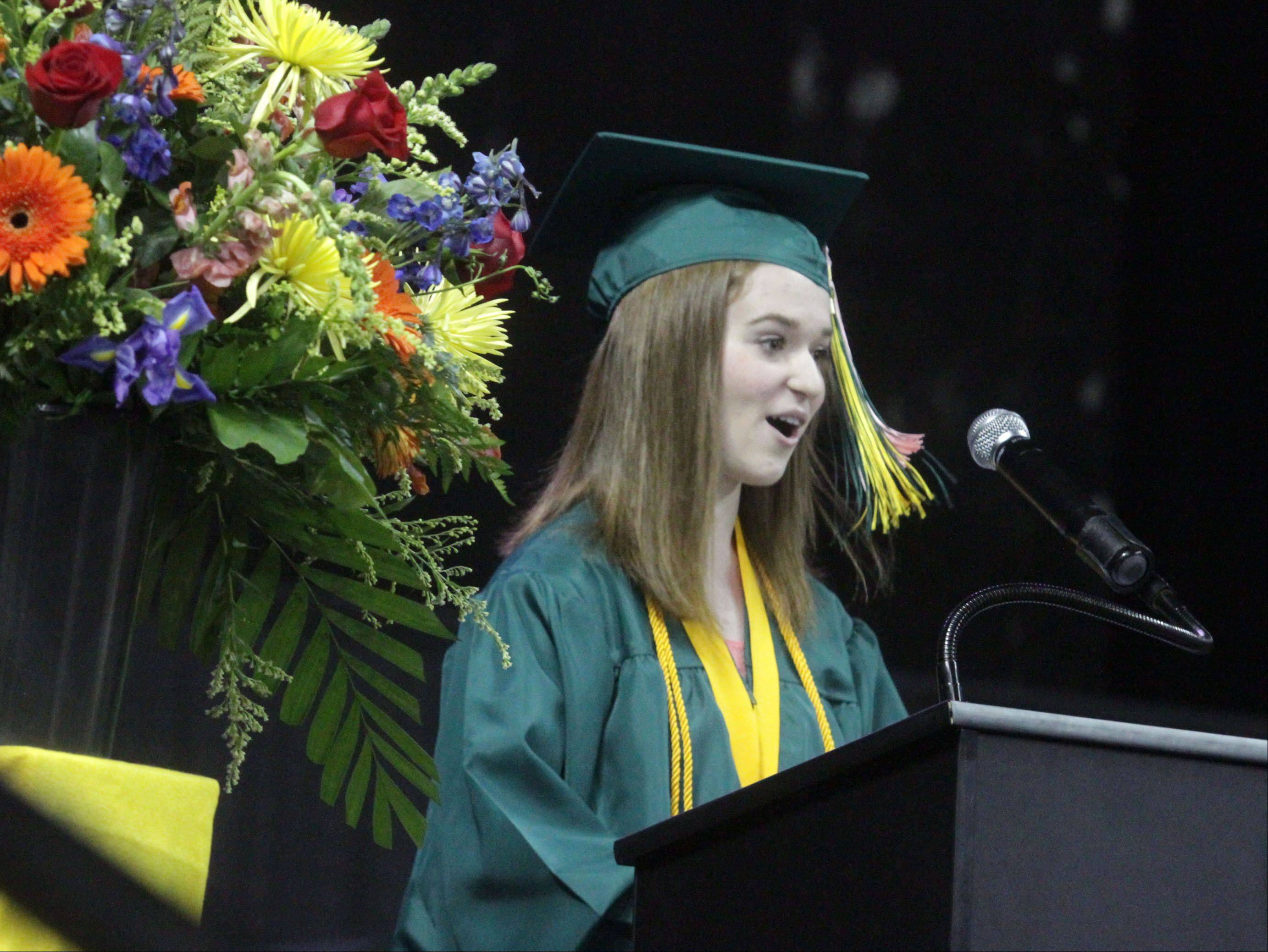 Elizabeth Davies-Hogg gives the senior address at Fremd High School's commencement ceremony at the Sears Centre in Hoffman Estates on Sunday.