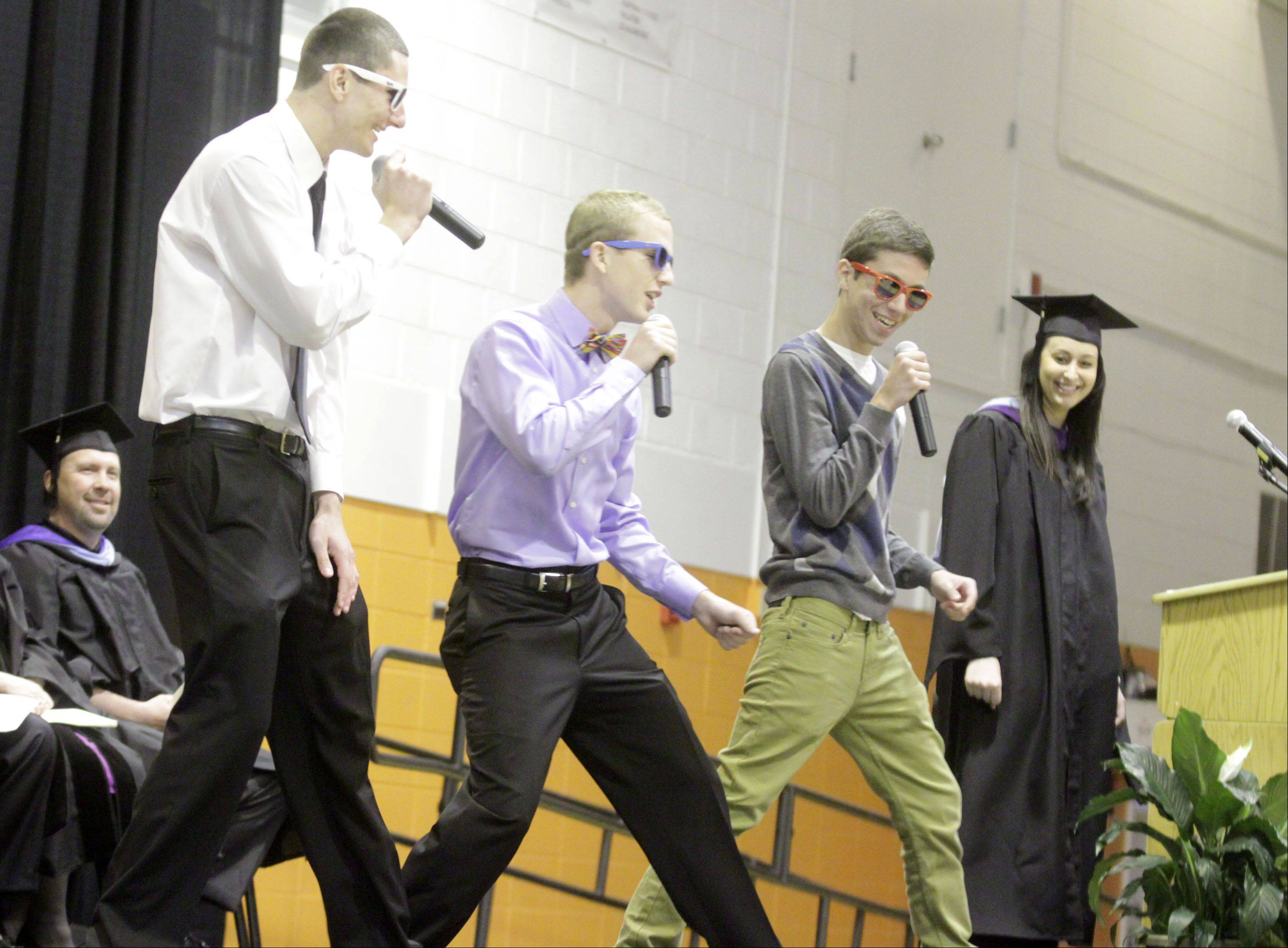 Rap group Mini-Van-Jam performs with graduation faculty speaker Patty Merris during Hersey High School's commencement exercises in Arlington Heights on Sunday, June 2, 2013.