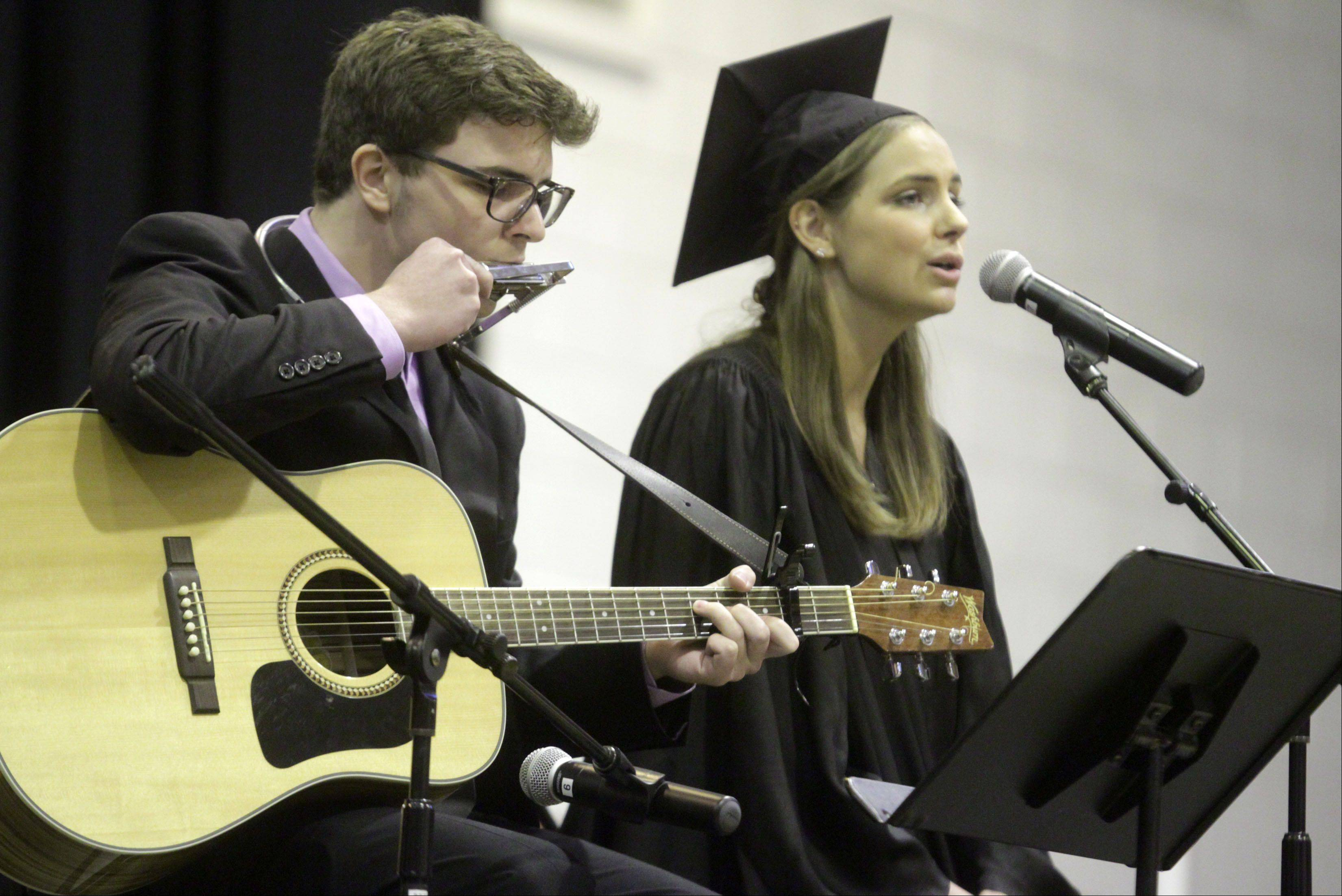 "Graduates Joseph and Jenna Borrelli perform ""Dream"" by Priscill Ahn at Hersey High School's commencement exercises in Arlington Heights on Sunday, June 2, 2013."
