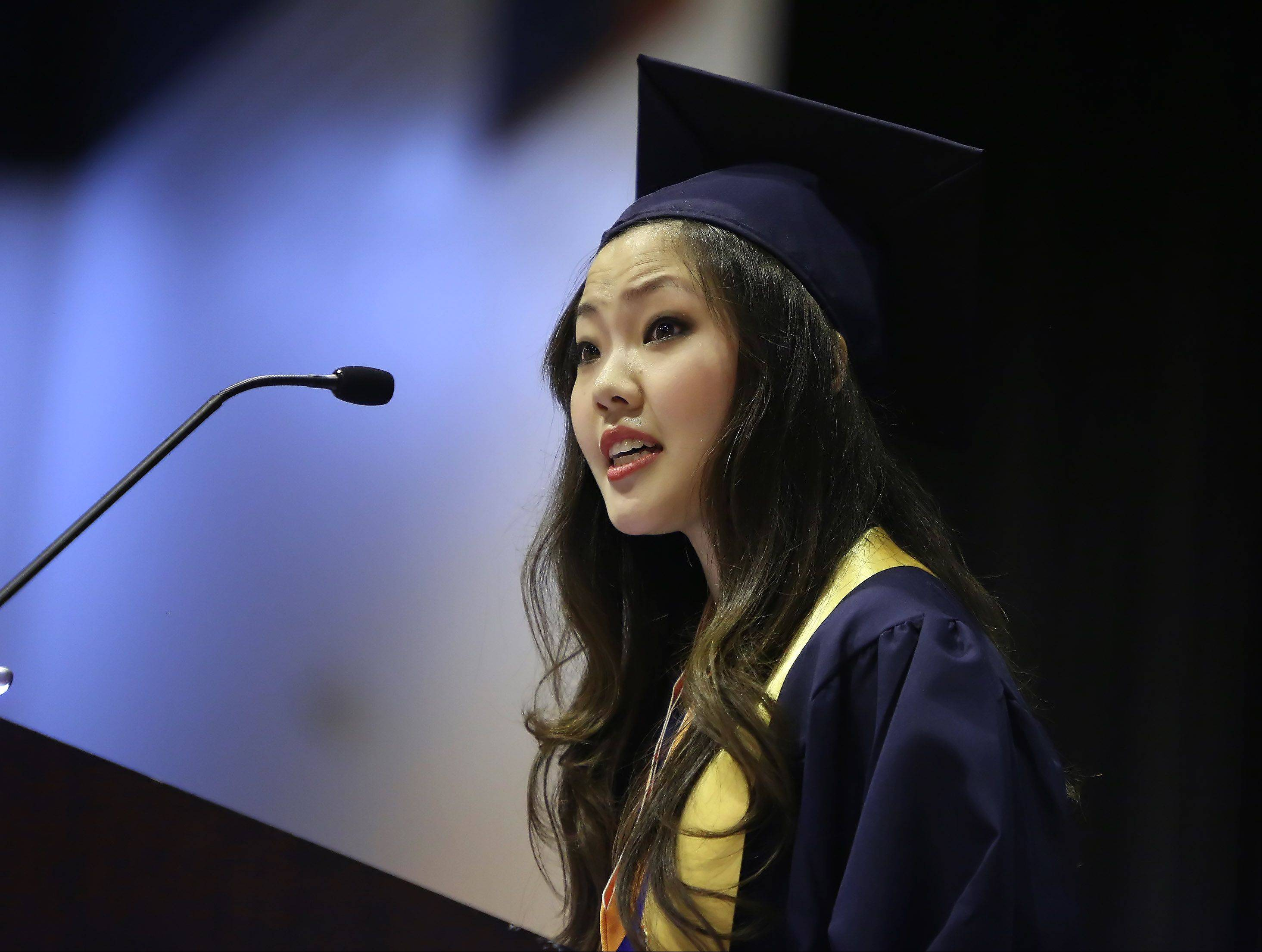 Student council president Hanah Chang gives a speech during the Buffalo Grove High School graduation on Sunday, June 2nd, at the school. There were 507 graduating seniors who participated in commencement exercises.