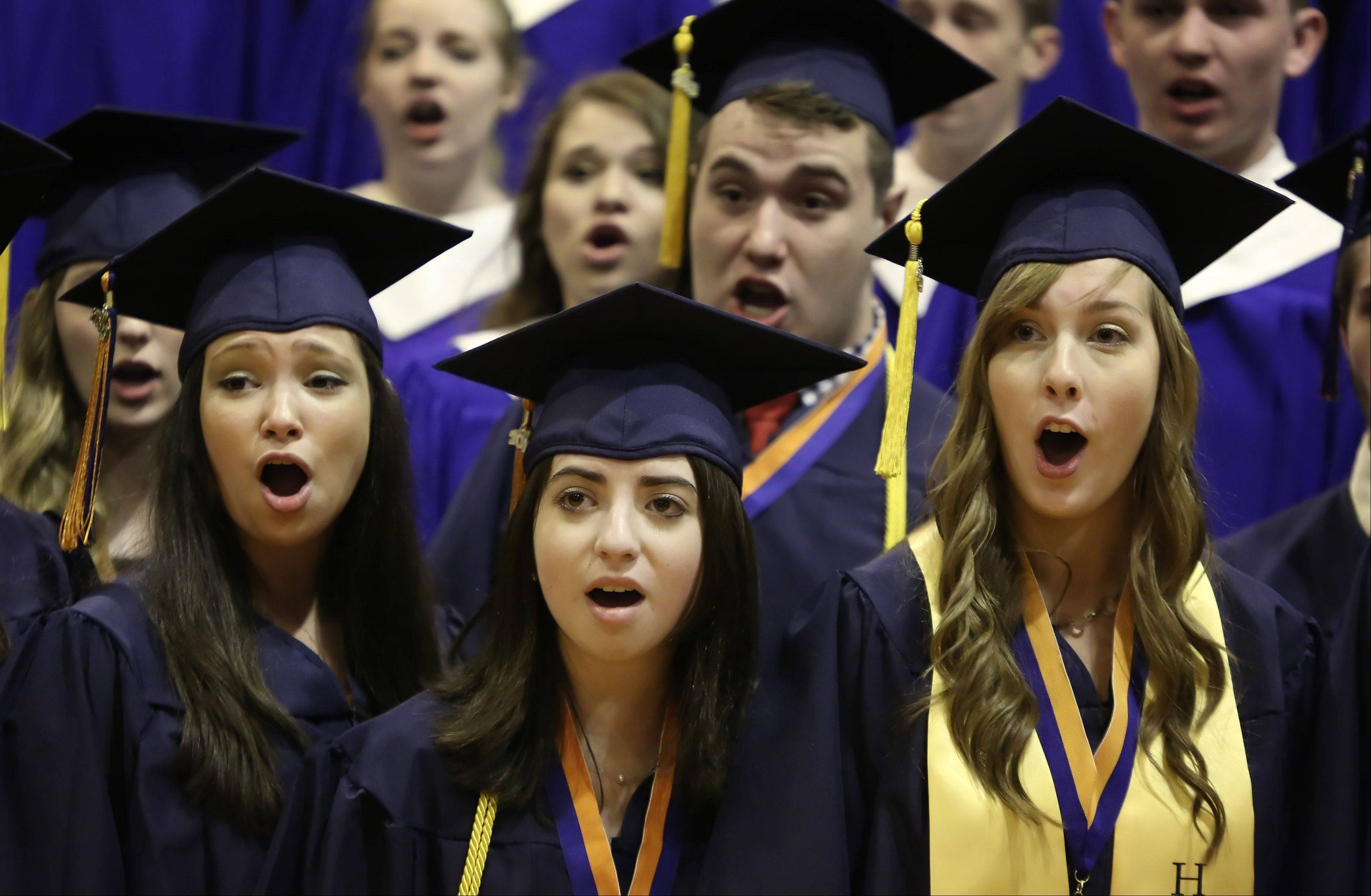 "Seniors join their classmates of the concert choir to sing ""Bridge Over Troubled Water"" during the Buffalo Grove High School graduation on Sunday, June 2nd, at the school. There were 507 graduating seniors who participated in commencement exercises."