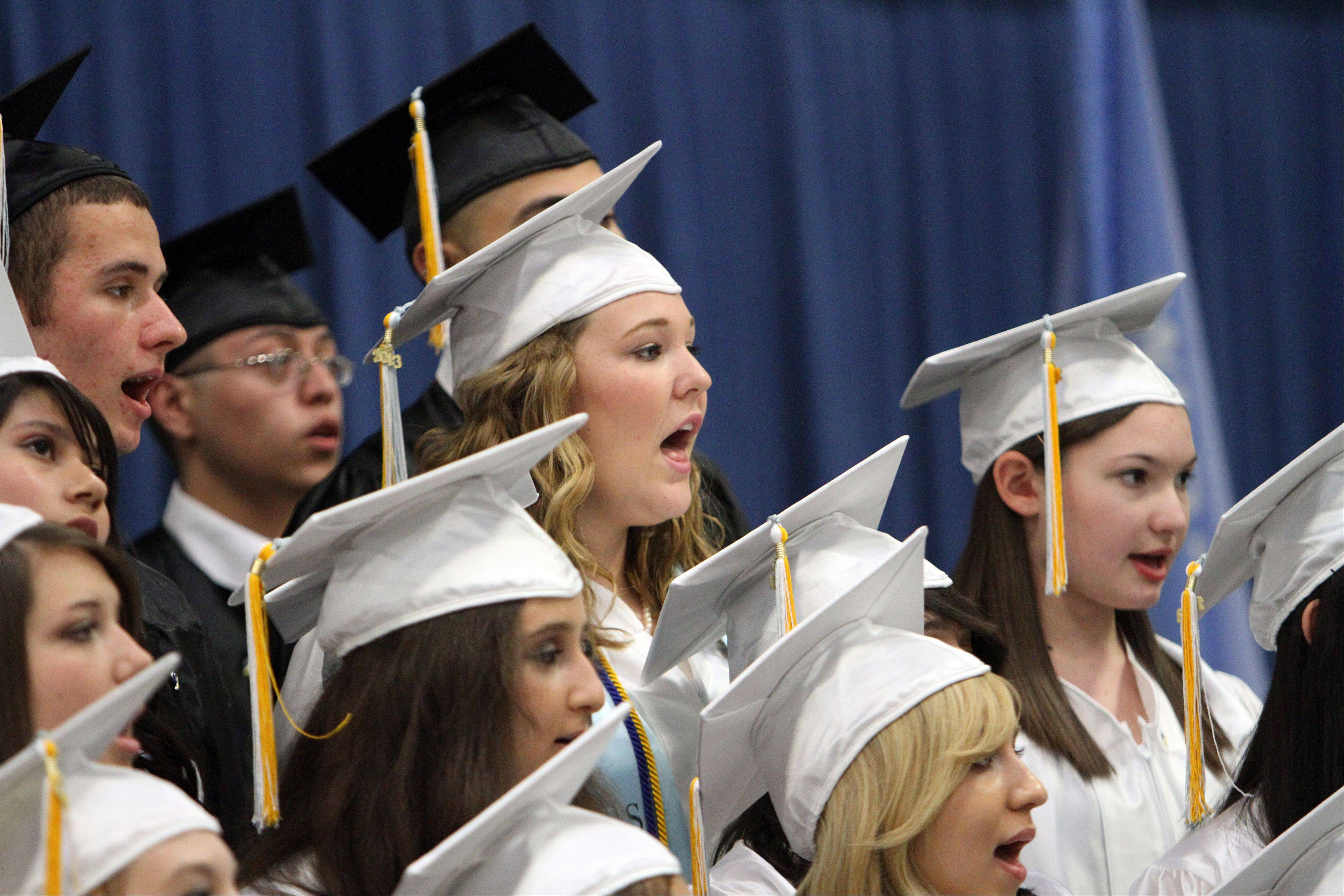 The Maine West senior choir performs during graduation ceremonies Sunday at Maine West High School.