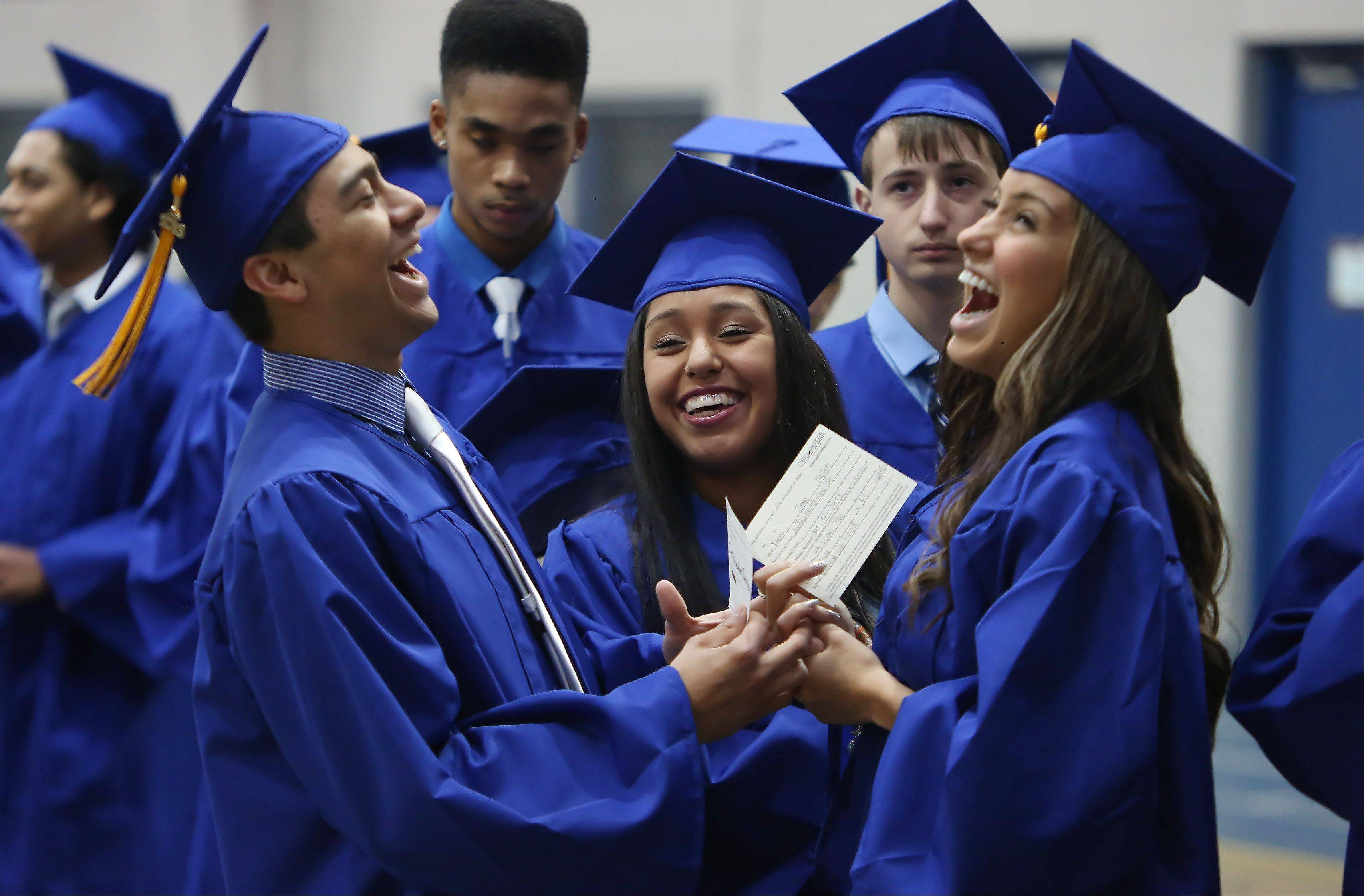 Chris Gonzalez, left, Concepcion Blancas, and Donna Bledsoe have a laugh together before the Wheeling High School graduation on Sunday, June 2nd, at the school. There were 425 graduating seniors who participated in commencement exercises