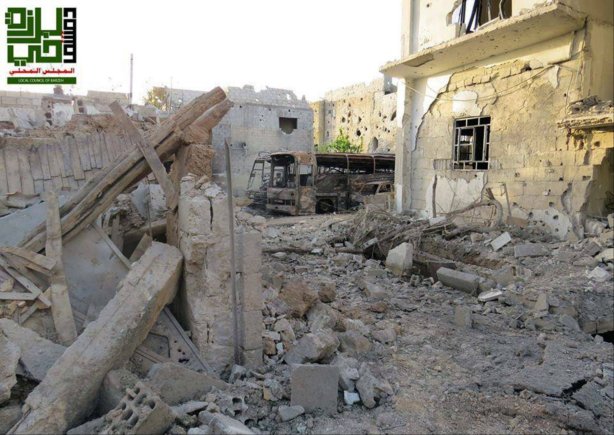 This citizen journalism image provided by the Local Council of Barzeh, which has been authenticated based on its contents and other AP reporting, shows destroyed homes from government airstrikes and shelling, in the Barzeh district of Damascus, Syria, Saturday.