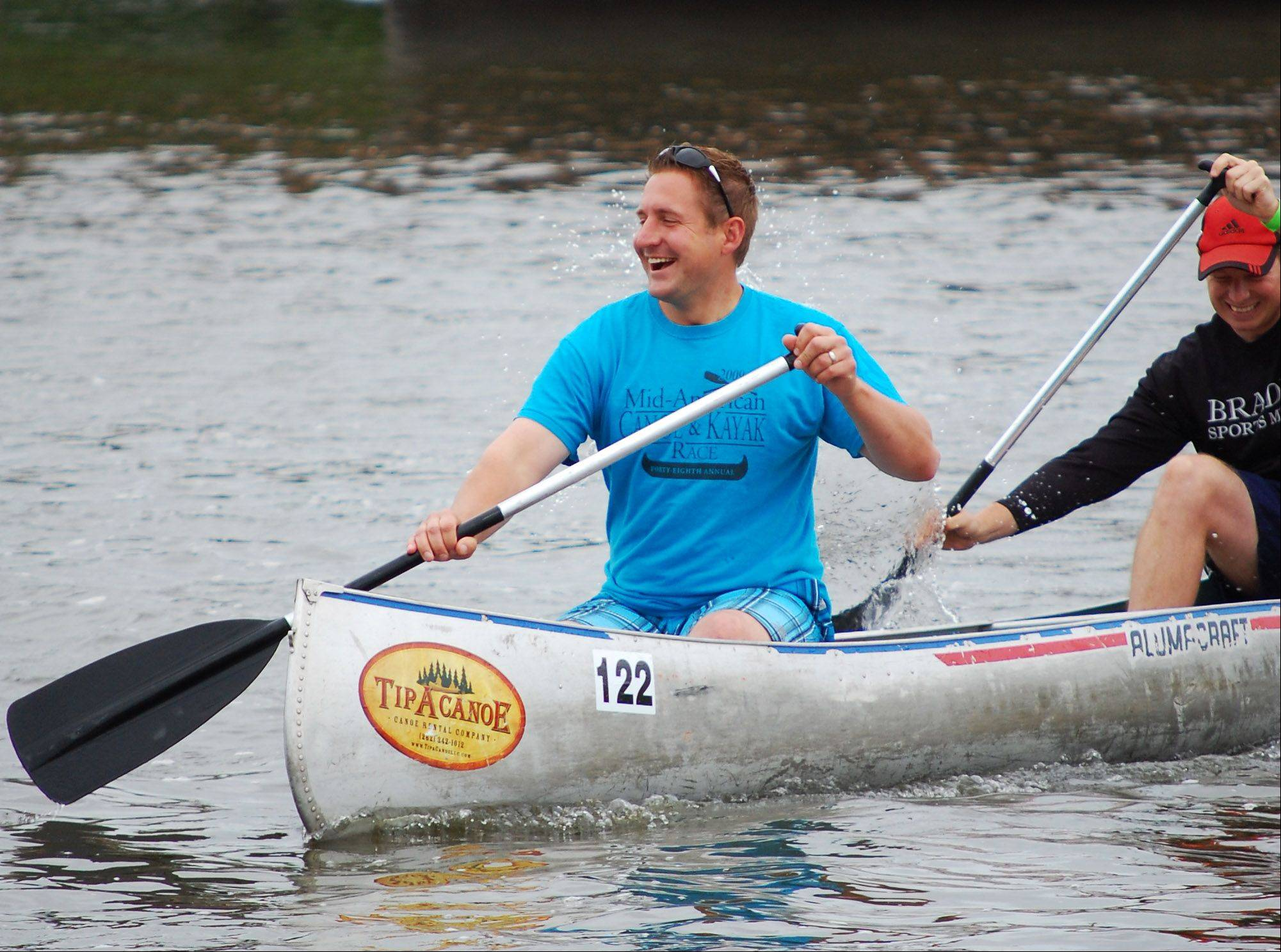 Dave Slowik of Oswego and Marcus Ohnemus of Plainfield got turned around while competing in the 52nd Mid-American Canoe and Kayak Race on Sunday. The race had heats starting from St. Charles and Batavia with both finishing at McCullough Park in Aurora.