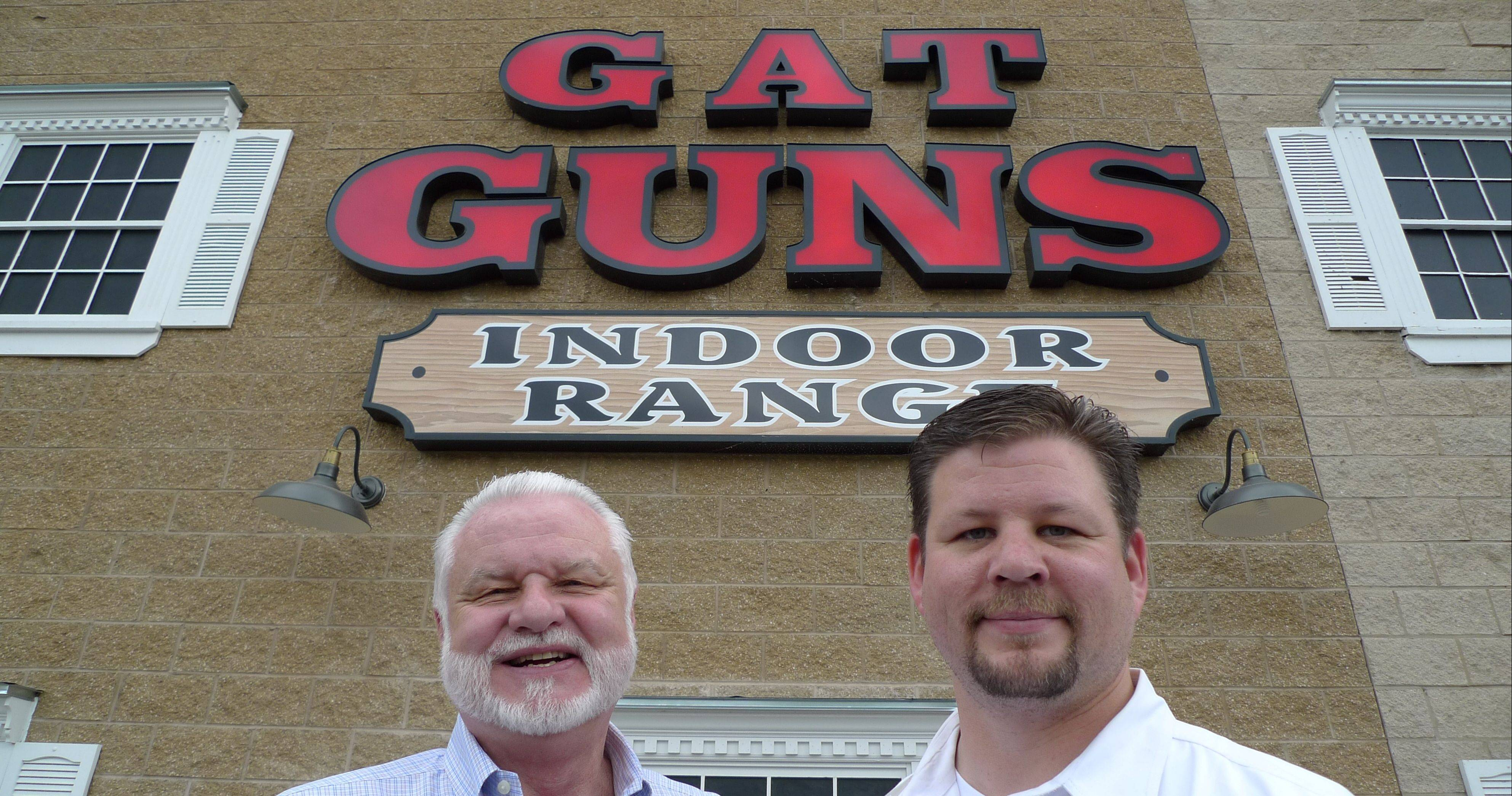 GAT Guns owner Greg Tropino, left, and employee Randy Potter are preparing for a grand reopening of their store to accommodate Illinoisans wanting to take advantage of the state's new conceal-and-carry law.