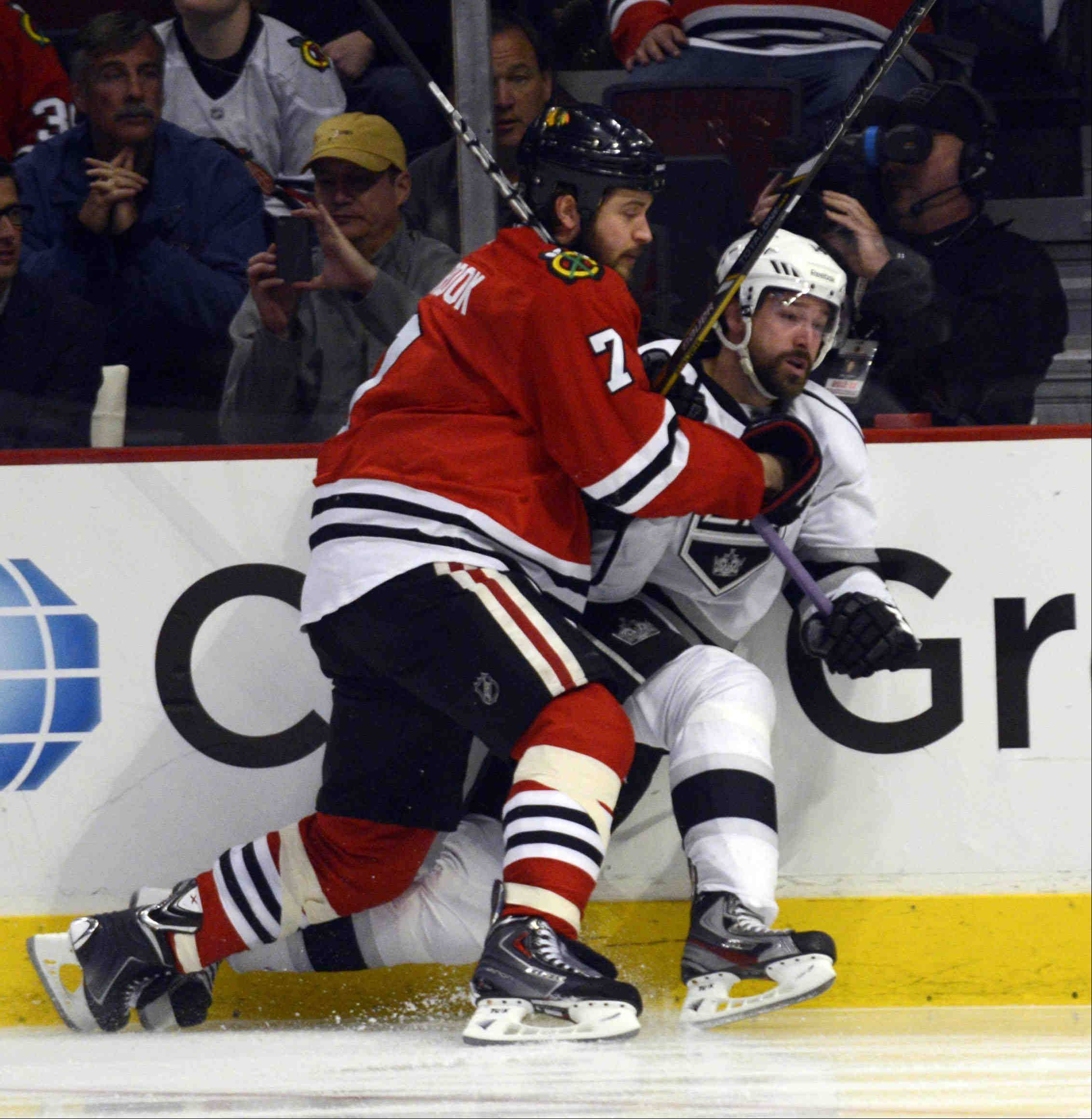 Chicago Blackhawks defenseman Brent Seabrook pins Los Angeles Kings right wing Justin Williams against the boards in the second period during game 2 of the NHL Western Conference finals at the United Center Sunday night in Chicago.