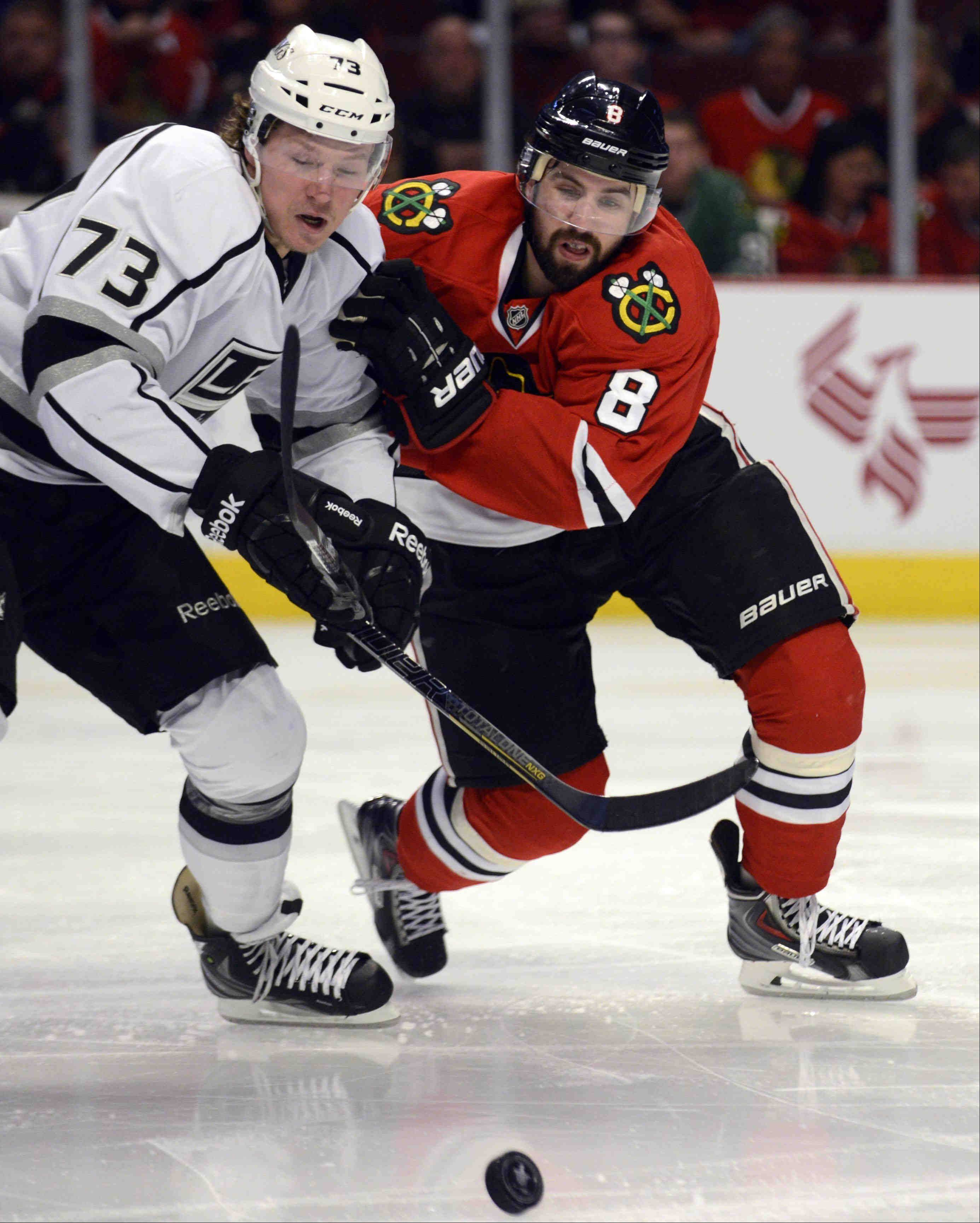 Chicago Blackhawks defenseman Nick Leddy battles with Los Angeles Kings center Tyler Toffoli during game 2 of the NHL Western Conference finals at the United Center Sunday night in Chicago.