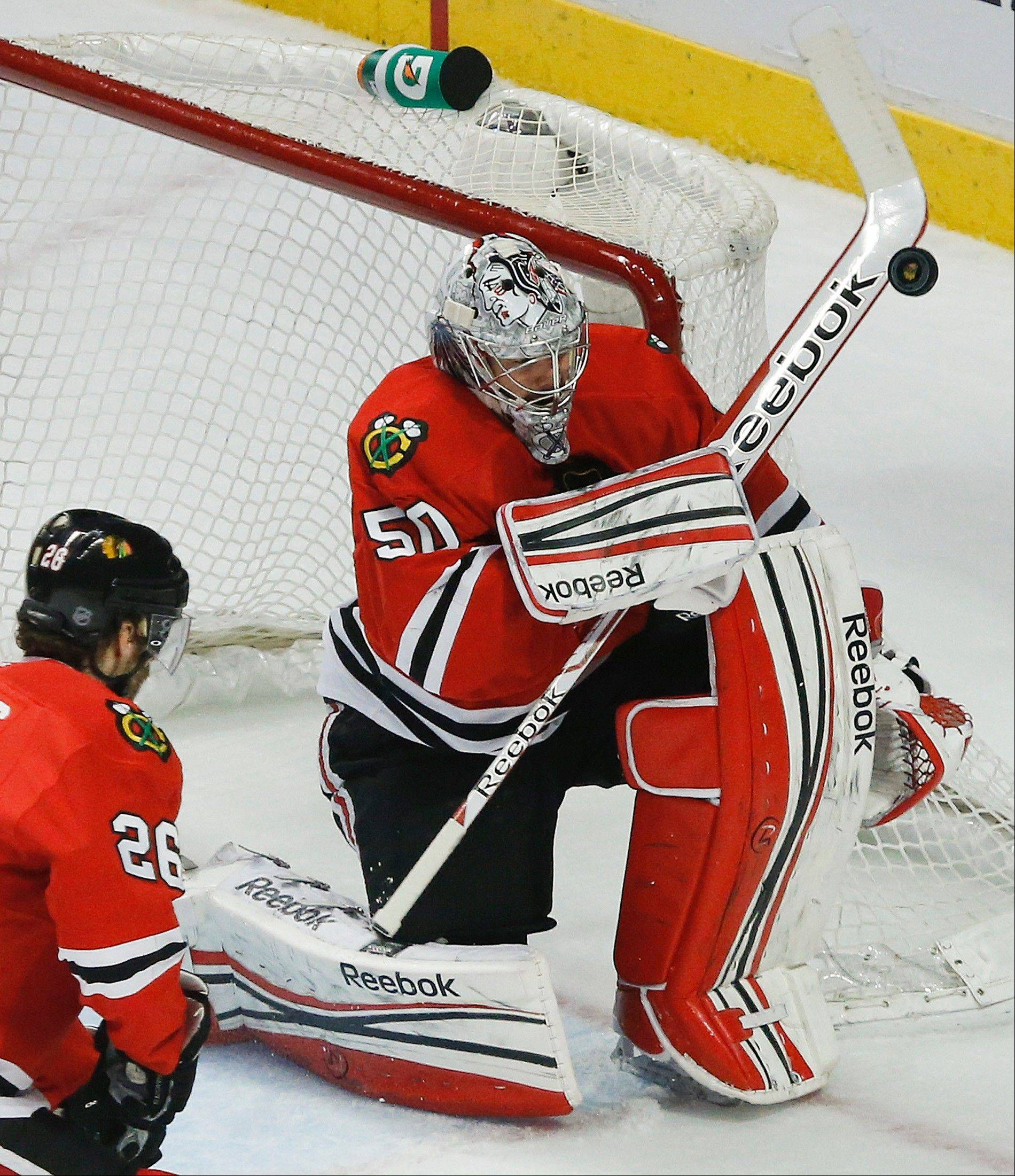 Chicago Blackhawks goalie Corey Crawford (50) blocks a shot by the Los Angeles Kings during the first period in Game 2 of the NHL hockey Stanley Cup Western Conference finals Sunday, June 2, 2013 in Chicago.