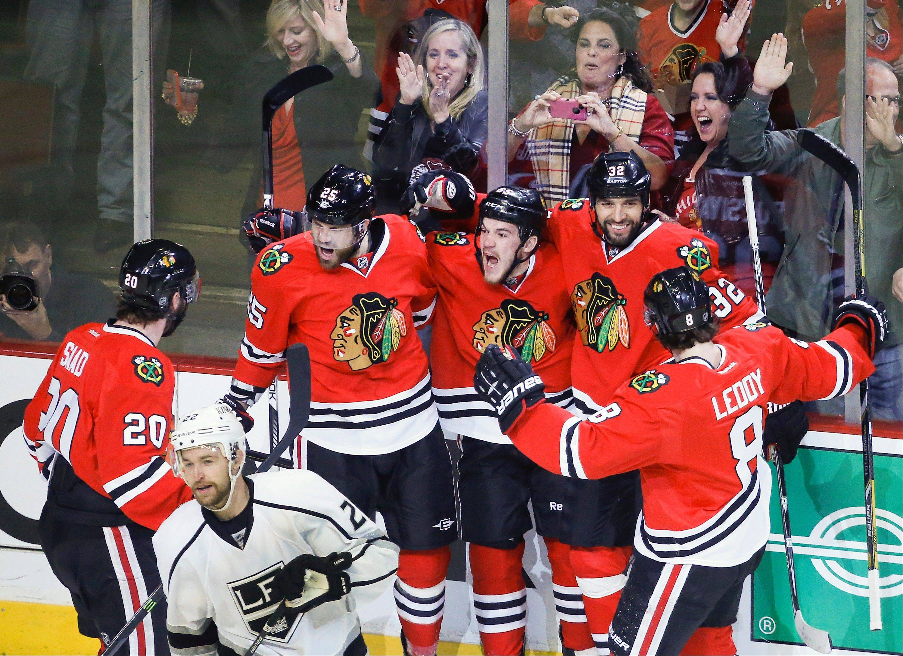 The Chicago Blackhawks celebrate after center Andrew Shaw (65) scored a goal against the Los Angeles Kings during the first period in Game 2 of the NHL hockey Stanley Cup Western Conference finals Sunday, June 2, 2013 in Chicago. The Blackhawks won 2-1.
