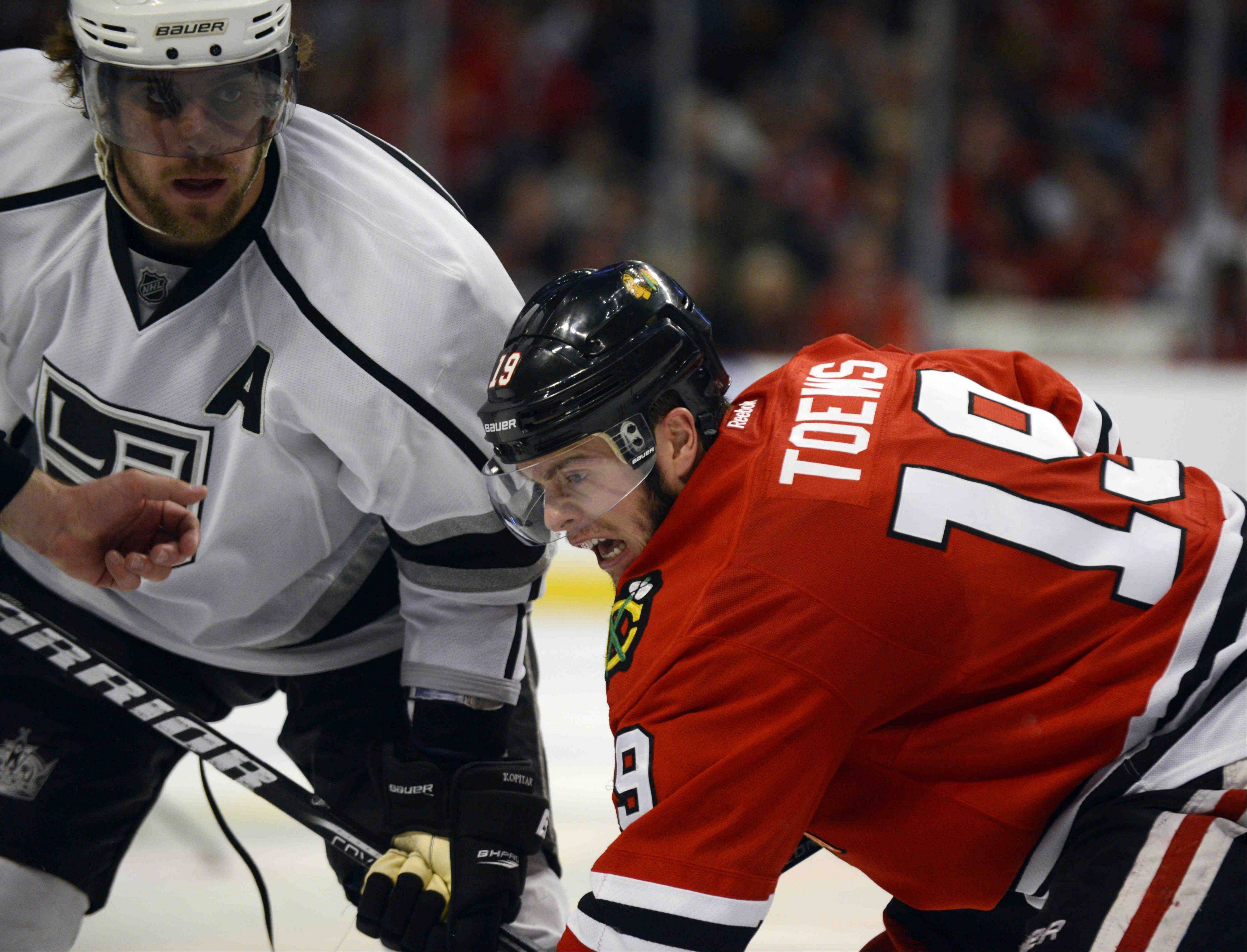 Chicago Blackhawks center Jonathan Toews battles with Los Angeles Kings center Anze Kopitar in a face off during game 2 of the NHL Western Conference finals at the United Center Sunday night in Chicago.