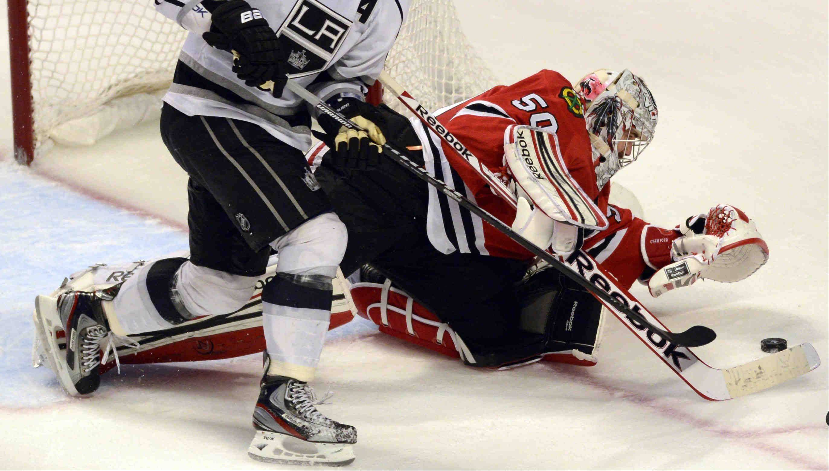 Chicago Blackhawks goalie Corey Crawford leans out of the net to make a save against the Los Angeles Kings during game 2 of the NHL Western Conference finals at the United Center Sunday night in Chicago.