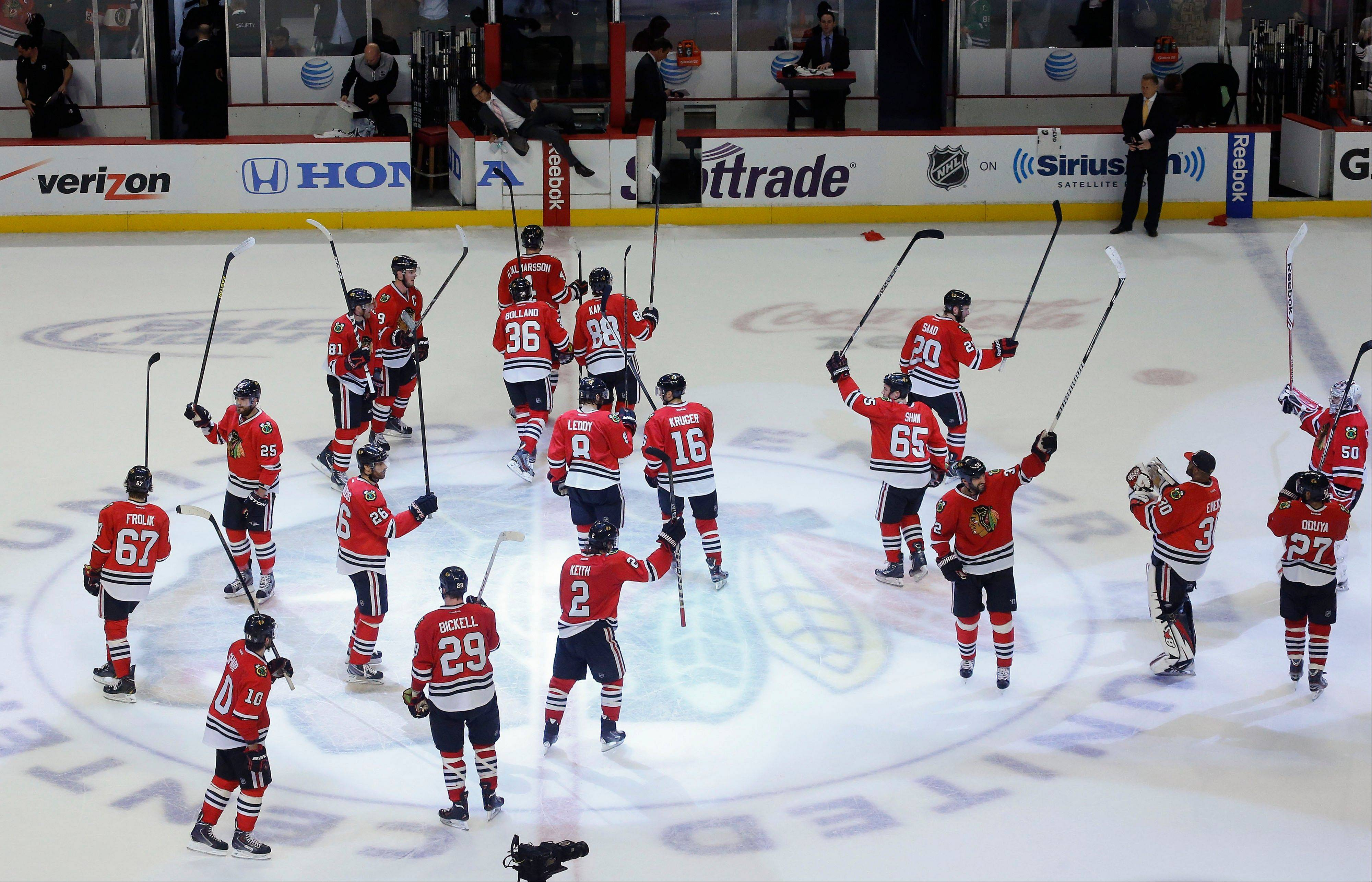 The Chicago Blackhawks celebrate after beating the Los Angeles Kings 4-2 in Game 2 of the NHL hockey Stanley Cup Western Conference finals Sunday, June 2, 2013 in Chicago.