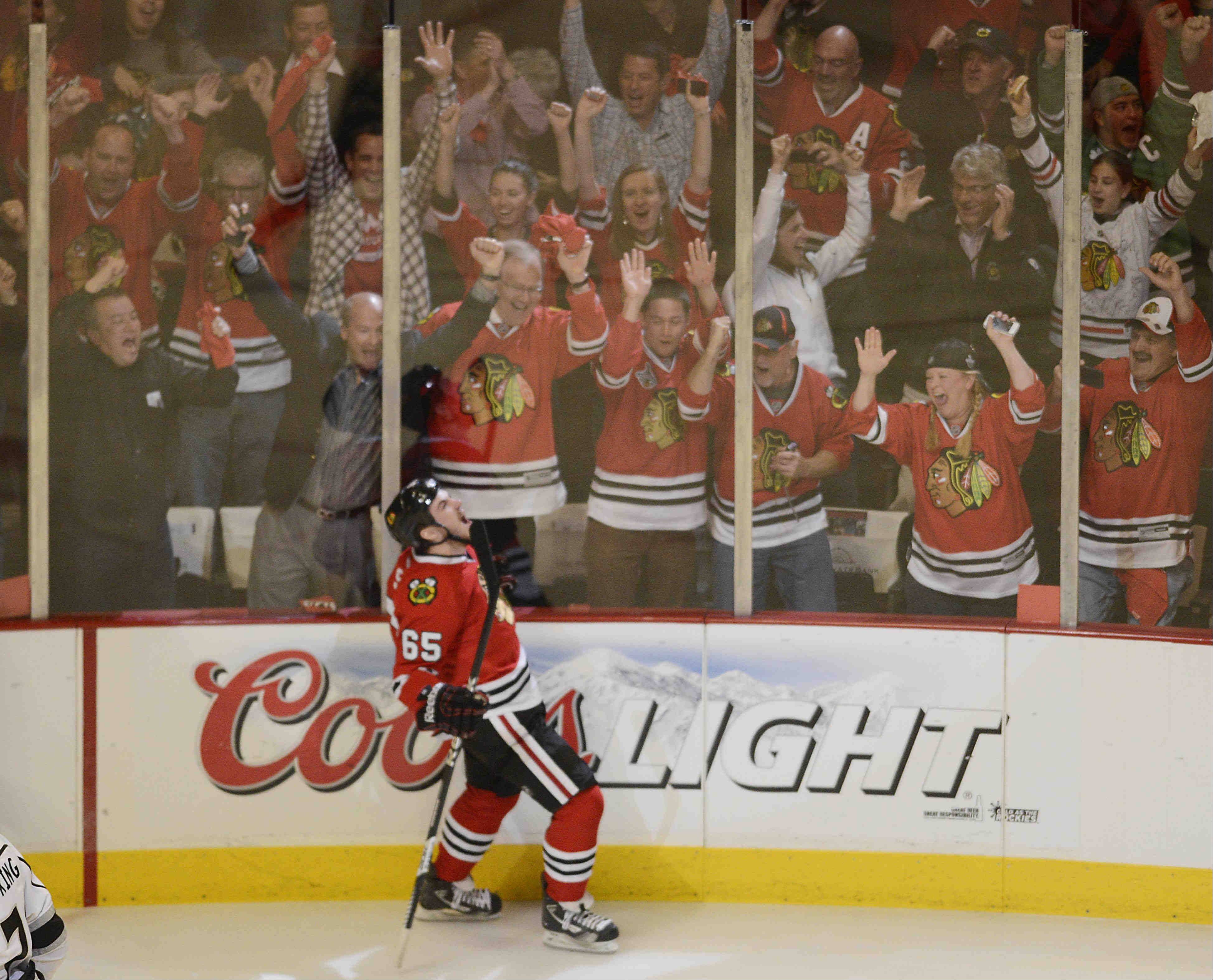 Chicago Blackhawks center Andrew Shaw howls after his first-period goal against the Los Angeles Kings during Game 2 of the NHL Western Conference finals at the United Center Sunday night in Chicago.