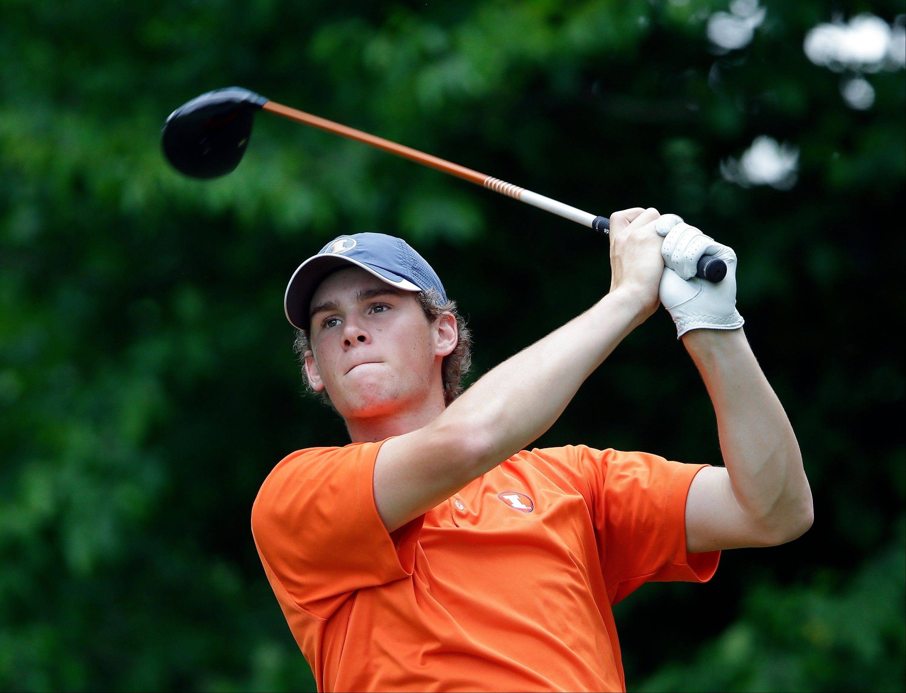Illinois' Thomas Detry hits from the tee on the 12th hole during the final round of play in the NCAA college men's golf championship against Alabama, Sunday, June 2, 2013, in Milton, Ga.