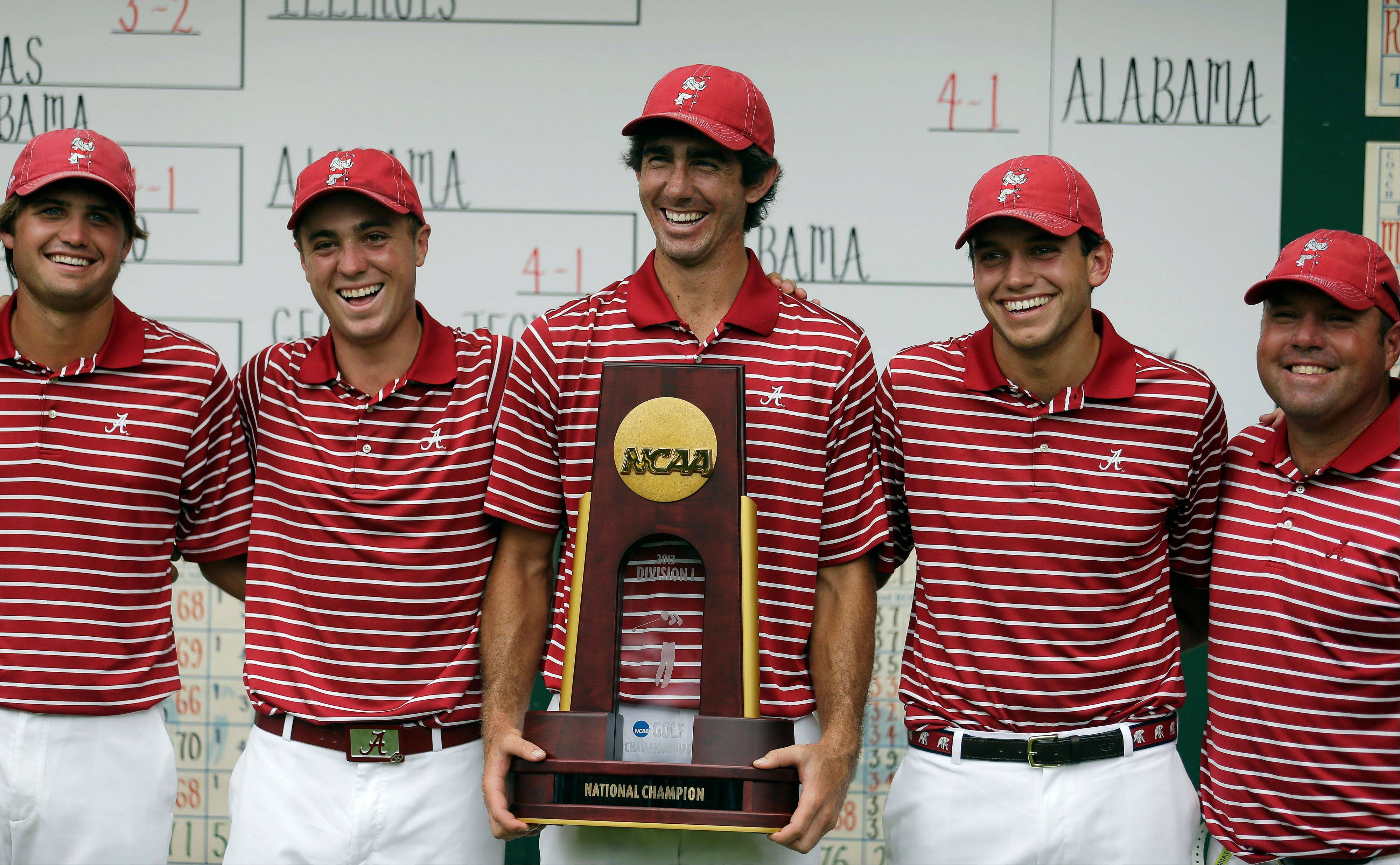 Alabama golfers, from left to right, Bobby Wyatt, Justin Thomas, Scott Strohmeyer, Cory Whitsett and assistant coach Rob Bradley poses with the trophy after defeating Illinois in the final round of play in the NCAA college men's golf championship against Alabama, Sunday, June 2, 2013, in Milton, Ga.