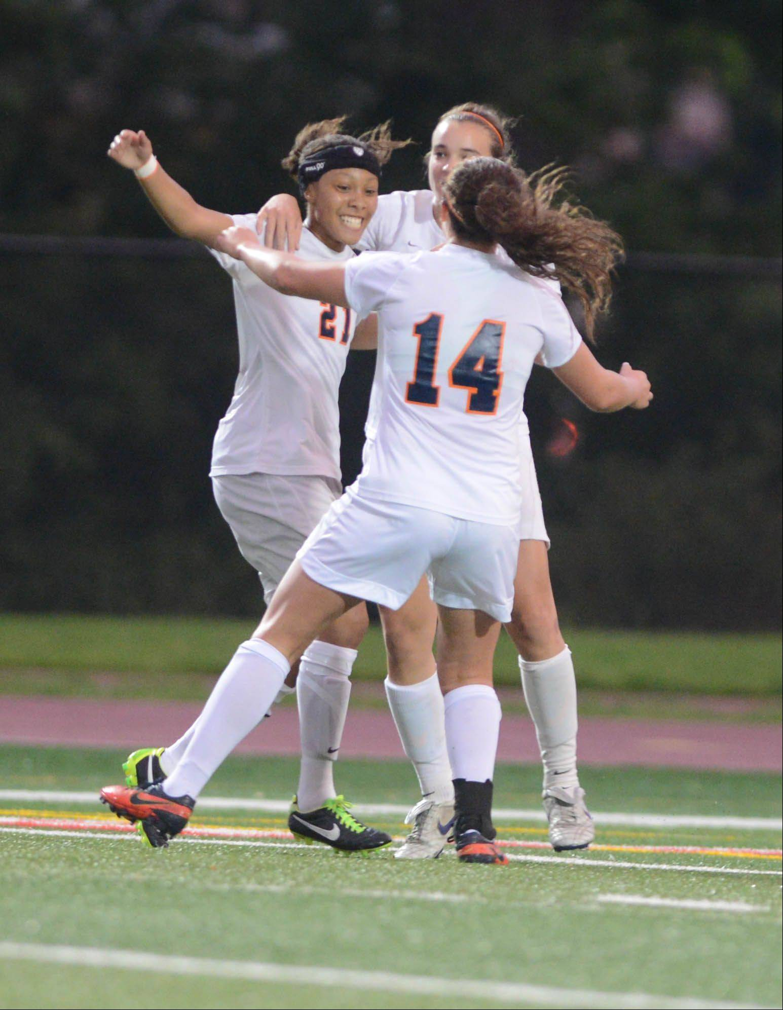 Zoe Swift and Christa Szalach of Napervile North celebrate a goal during theClass 3A girls soccer championship match in Naperville Saturday.
