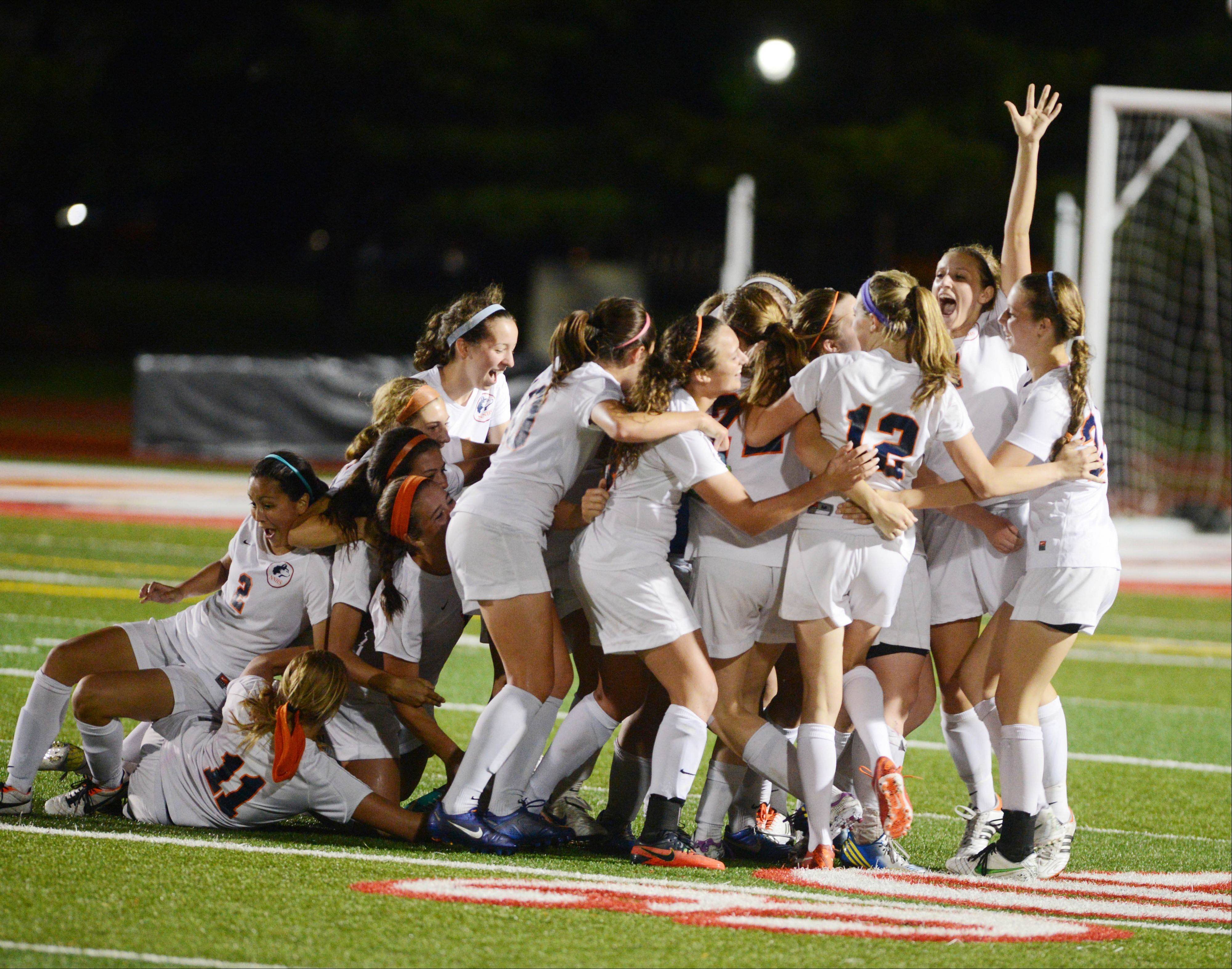 Naperville North celebrates their big win at the Class 3A girls soccer championship match in Naperville Saturday.