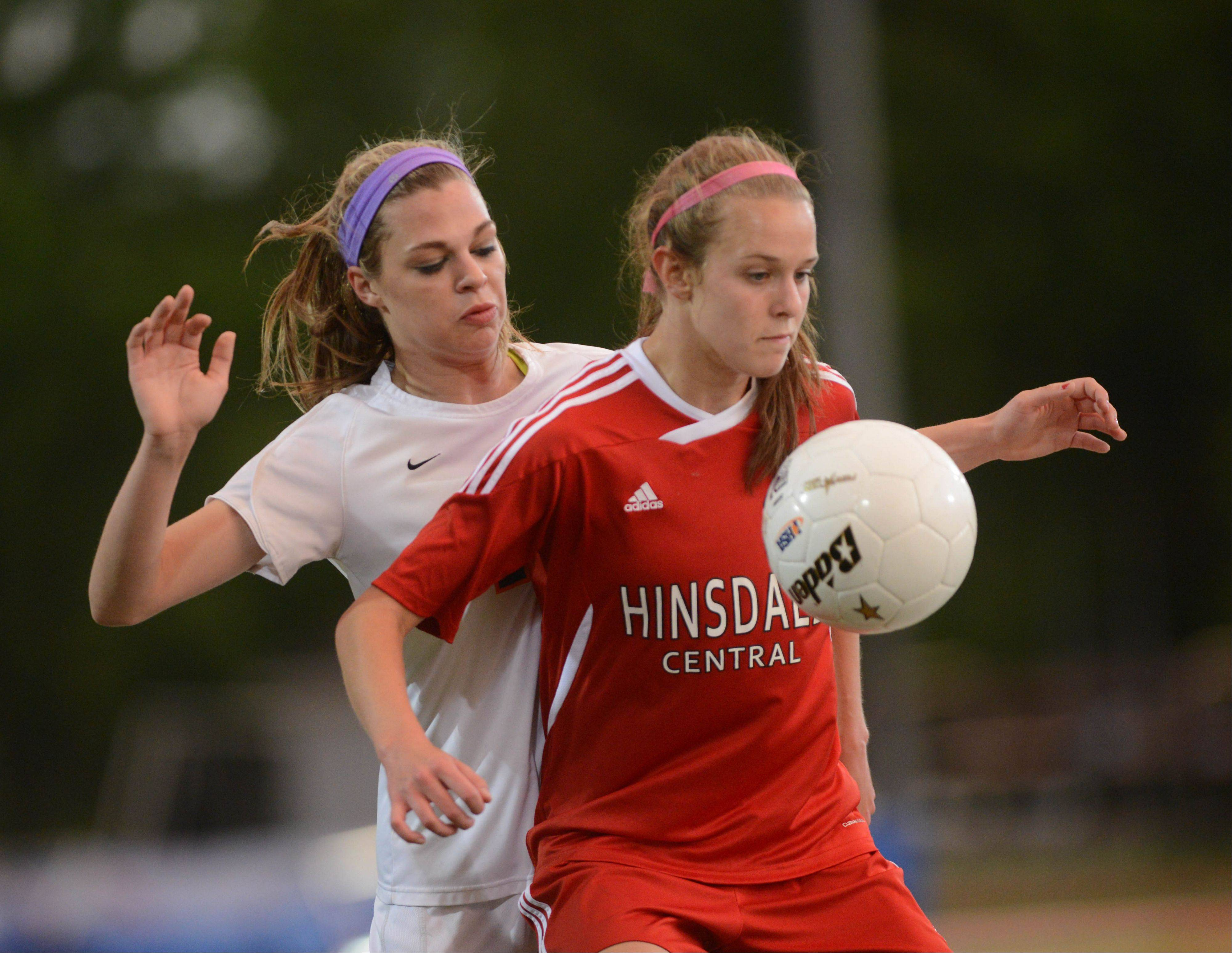 Abby Mangefrida of Naperville North and Casey May of Hinsdale Central vie for the ball during the Class 3A girls soccer championship in Naperville Saturday.
