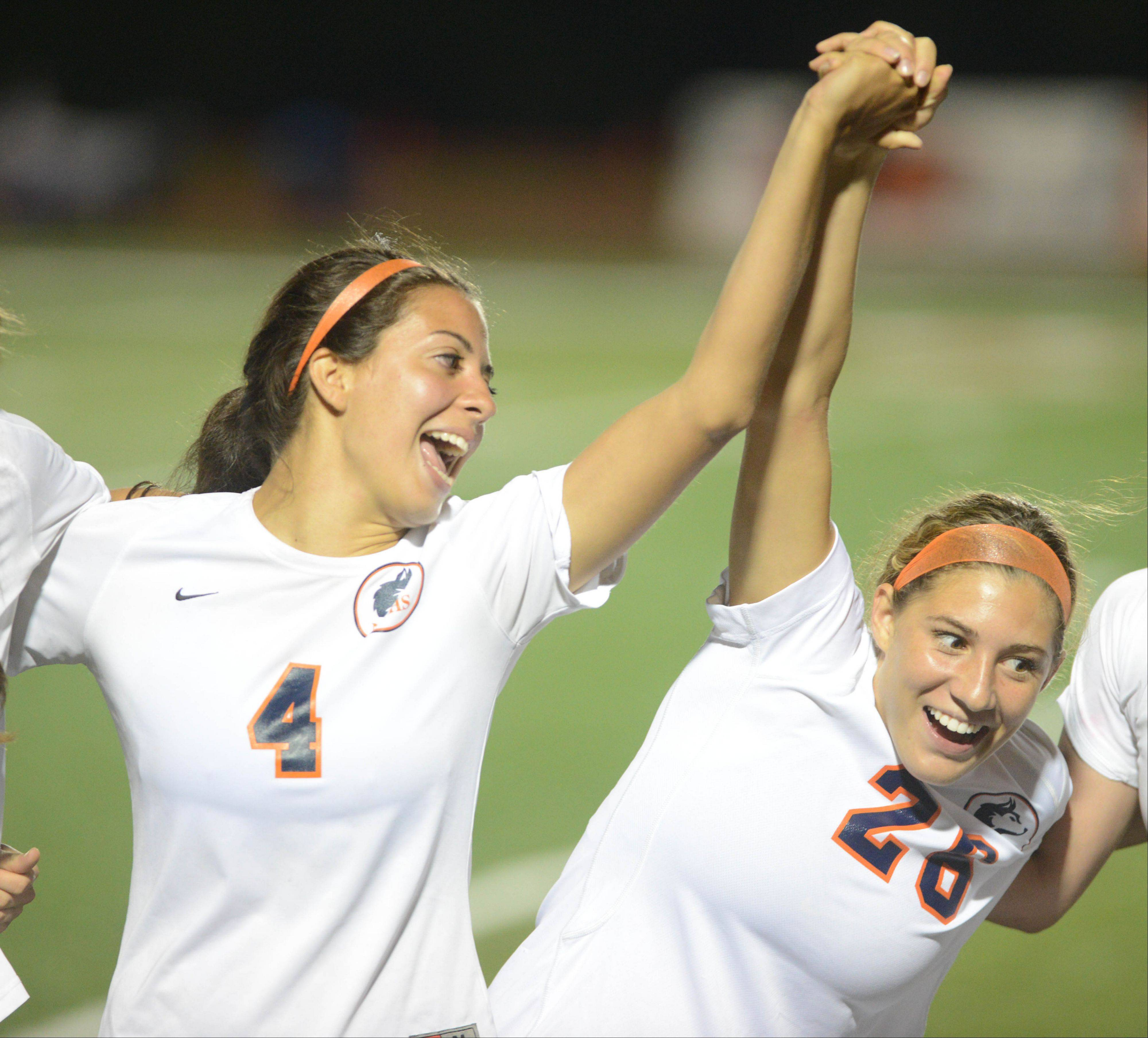 Caroline Rico,left, and Caroline Casas of Naperville North celebrate their big win at the Class 3A girls soccer championship match in Naperville Saturday.