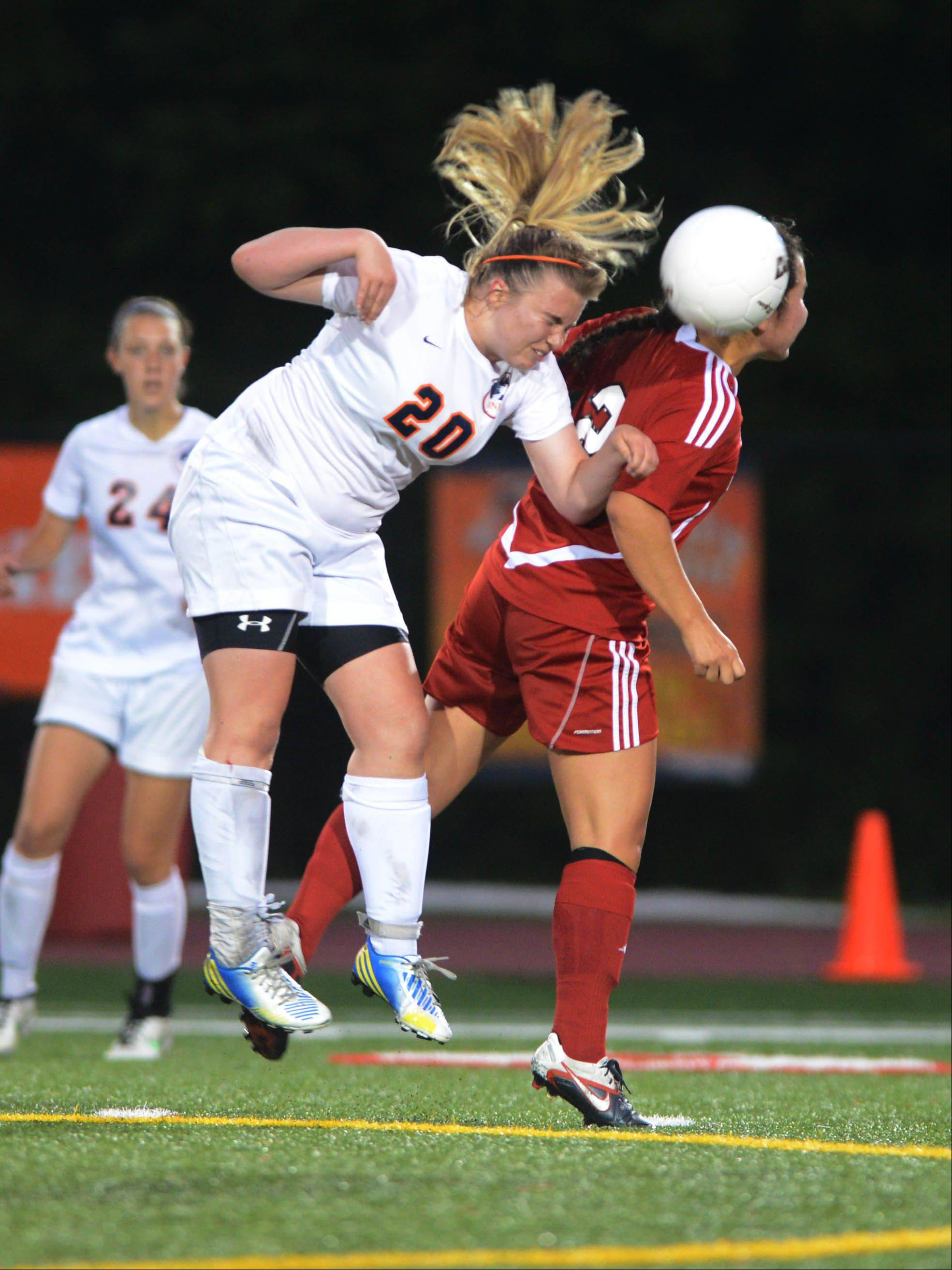 Emily Bromagen of Naperville North and Caitlin Smith of Hinsdale Central vie for the ball during the Class 3A girls soccer championship match in Naperville Saturday.