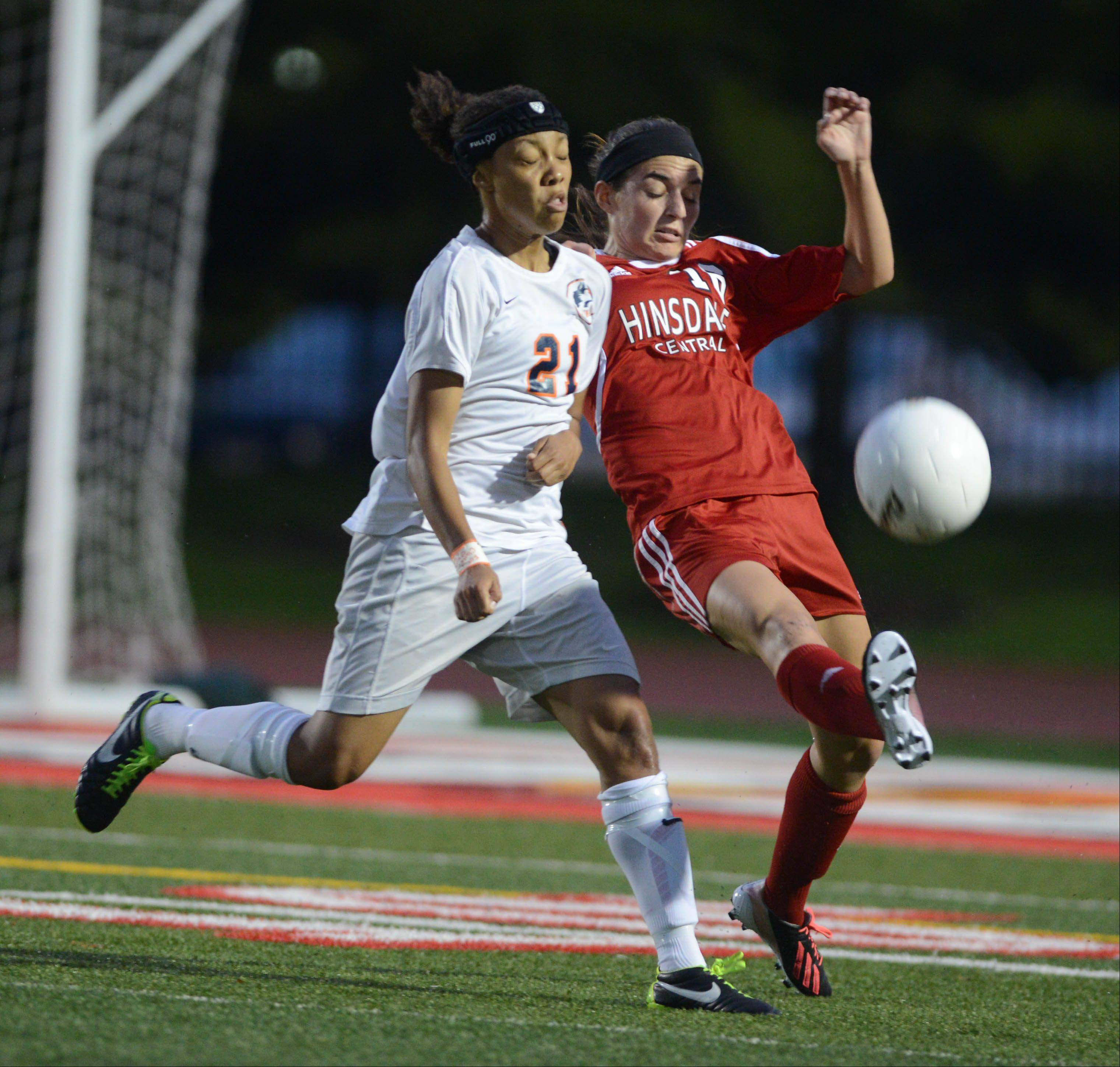 Zoe Swift,left, of Naperville North and Katherine Treankler of Hinsdale Central chase down a ball during the Class 3A girls soccer championship match in Naperville Saturday.