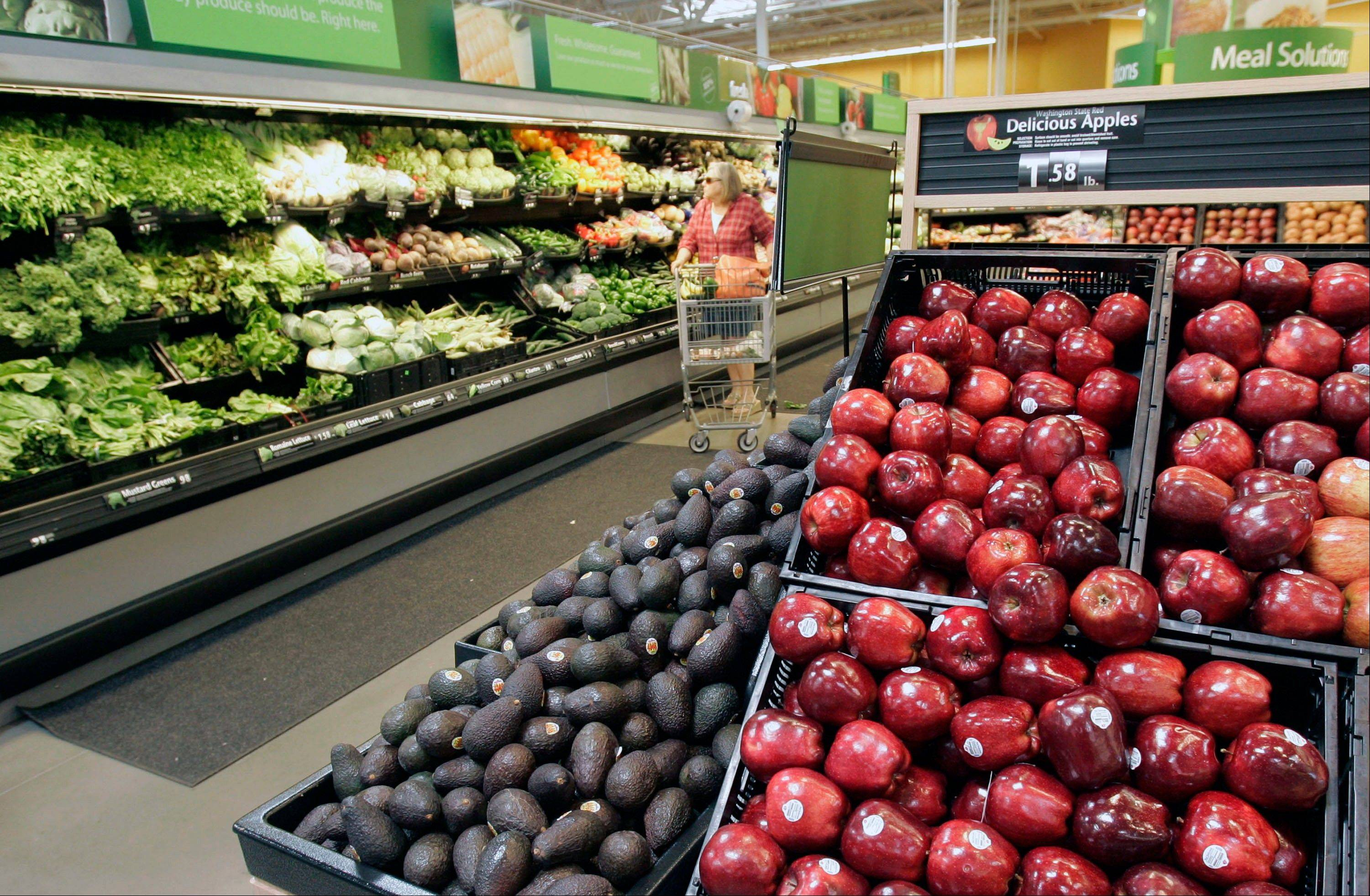 A woman shops for produce in a Maumelle, Ark., Wal-Mart Stores Inc., Supercenter store. The nation�s largest grocer and retailer announced steps Monday to improve the quality of its fresh fruits and vegetables.
