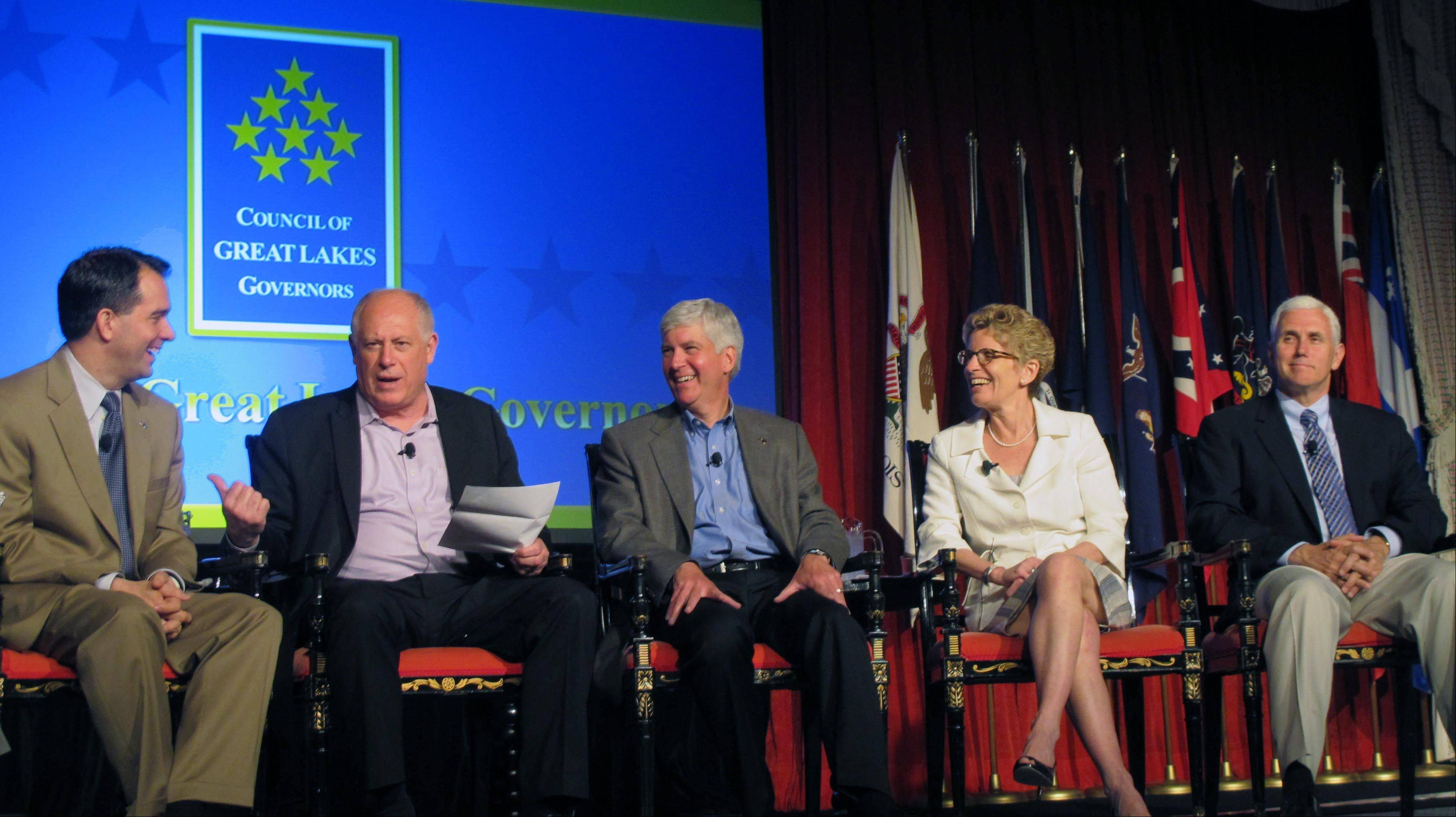 In this photo taken June 1, 2013, on Mackinac Island, Mich., members of the Council of Great Lakes Governors discuss regional policies on trade and water quality. From left: Wisconsin Gov. Scott Walker, Illinois Gov. Pat Quinn, Michigan Gov. Rick Snyder, Ontario Premier Kathleen Wynne, and Indiana Gov. Mike Pence.