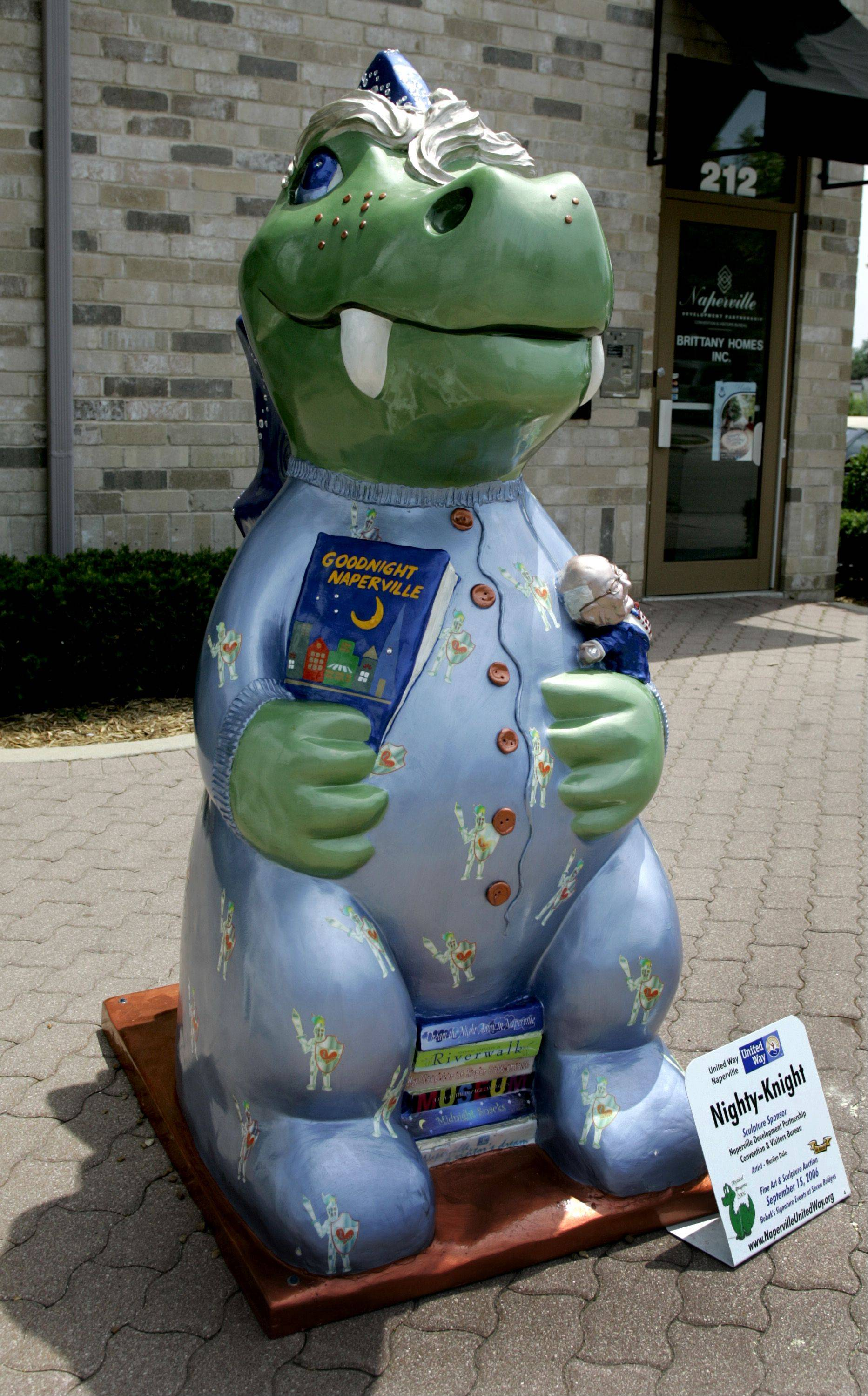 "Naperville Mayor George Pradel said the dragon statue in his front yard was removed early Saturday morning and thrown over a bridge toward the railroad tracks at Columbia Avenue and Plank Road. The dragon, called ""Nighty-Knight"" by artist Marilyn Dale, was auctioned in 2006 as part of a public art fundraiser for the Naperville United Way. ""It was kind of personal for me,"" Pradel said about the dragon, which carries a miniature statuette of the mayor himself in its left arm and a book called ""Goodnight Naperville"" in its right."