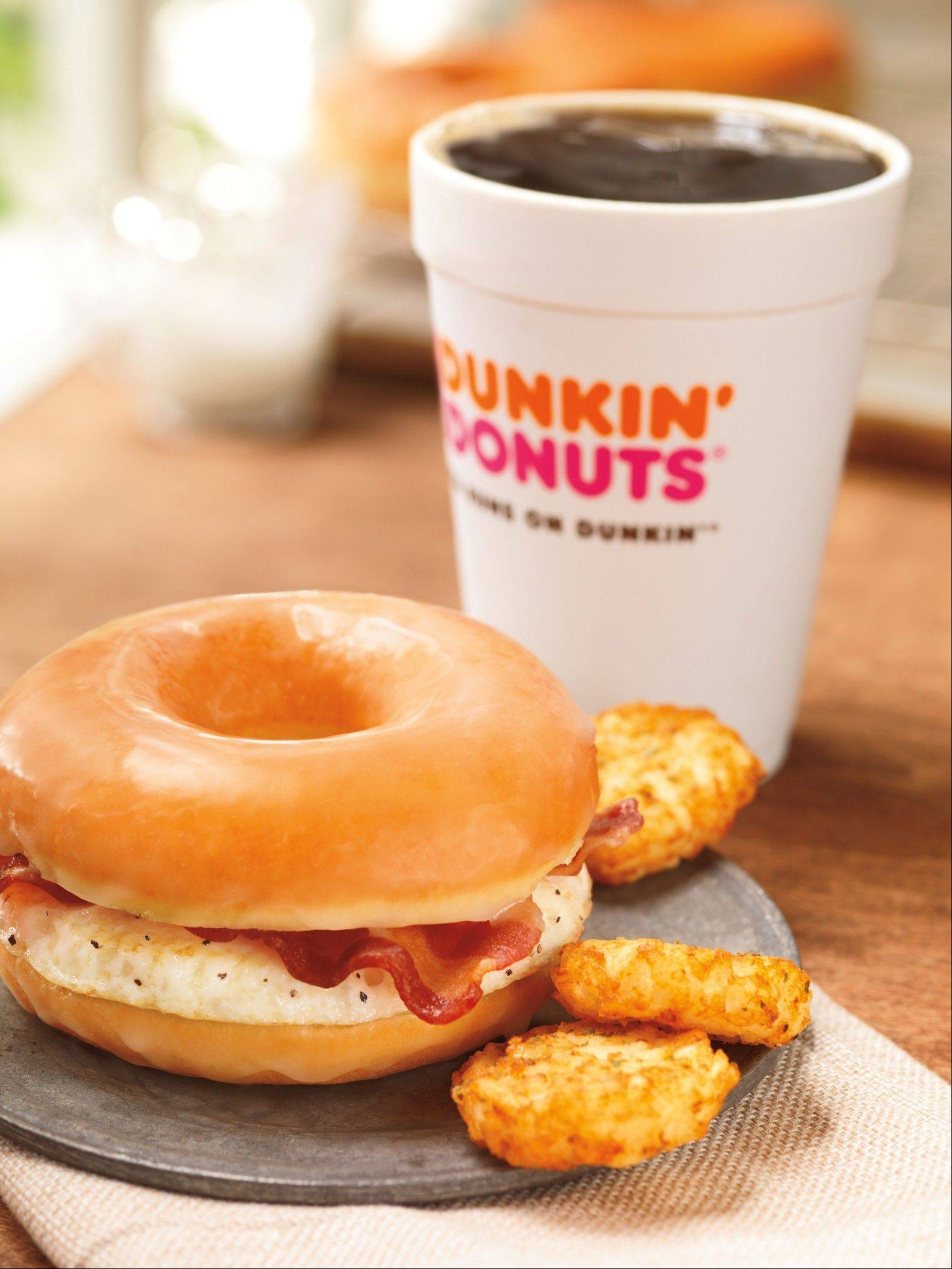 Dunkin' Donuts' glazed donut breakfast sandwich. Even as fast-food chains tout their healthy offerings, they're also coming up with fatty new treats to keep customers interested.