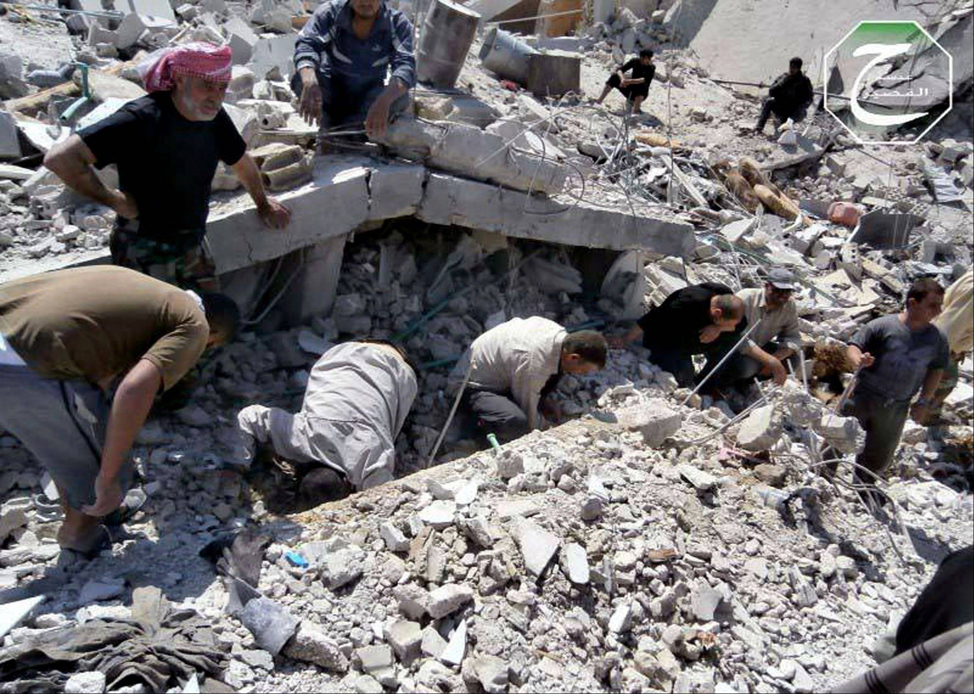 Syrian citizens inspect the rubble of buildings that were damaged from a Syrian forces airstrike in the town of Qusair, near the Lebanon border, Homs province, Syria. Cut off for three weeks by a regime siege, doctors in the Syrian town of Qusair keep hundreds of wounded in storerooms and underground shop cellars, short on antibiotics and anesthesia, using unsterilized cloth for bandages and blowing air with pumps because there�s no oxygen canisters, amid relentless shelling and sniper fire. More than a dozen have died from untreated wounds and at least 300 others need immediate evacuation, one doctor says.