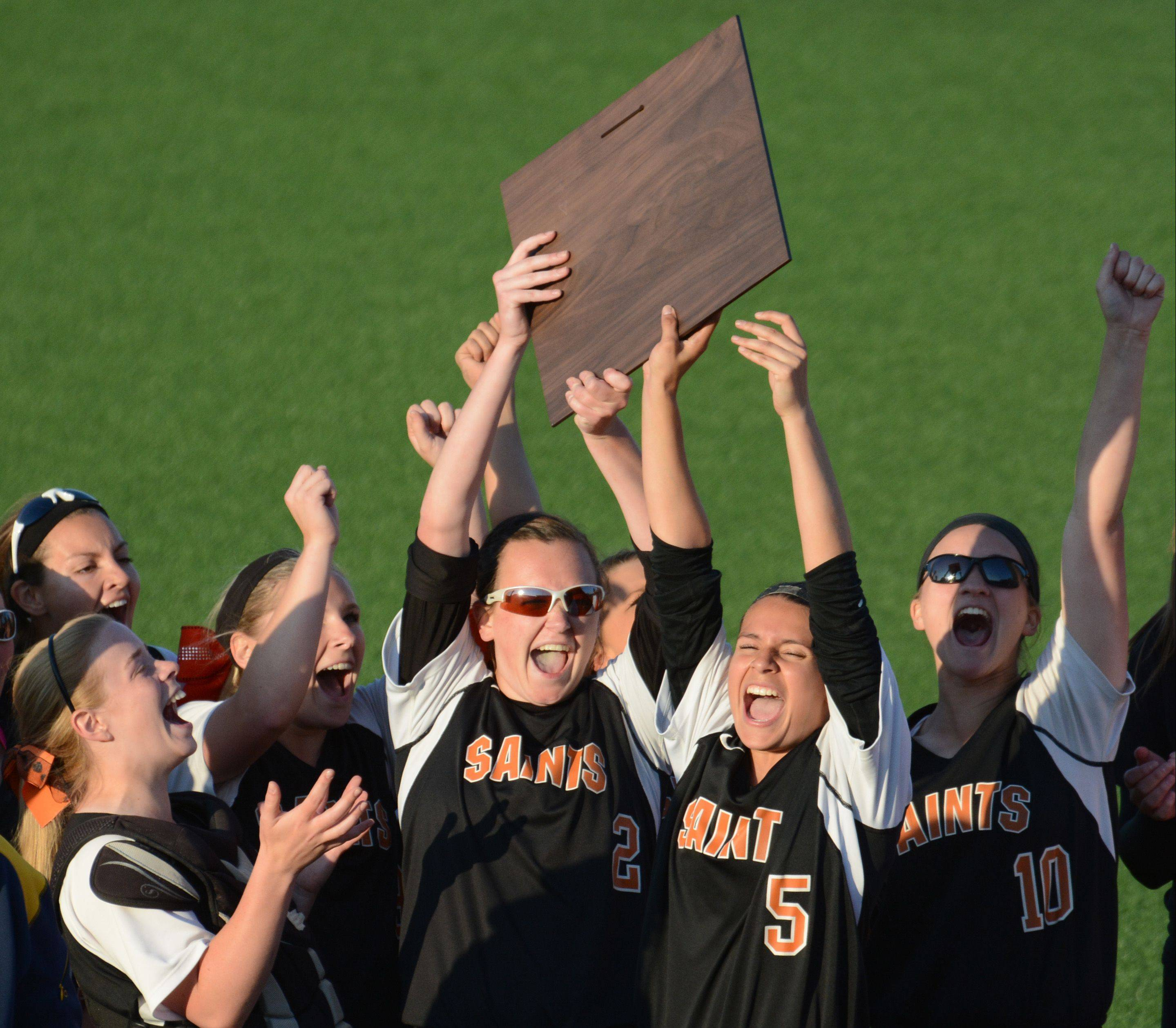 The Saint Charles East Saints celebrate after winning the Class 4A super sectional in Rosemont Monday.