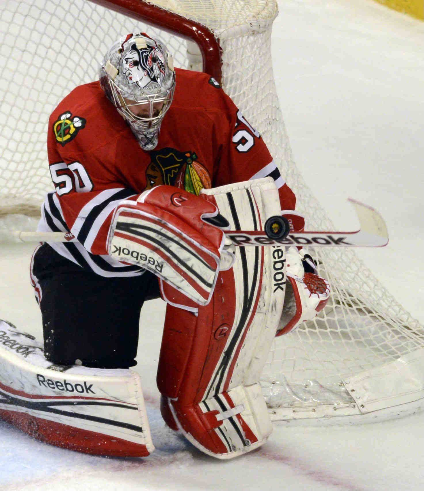 Blackhawks goalie Corey Crawford makes a save in the first period against the Los Angeles Kings during game 2 of the NHL Western Conference finals at the United Center Sunday night in Chicago.