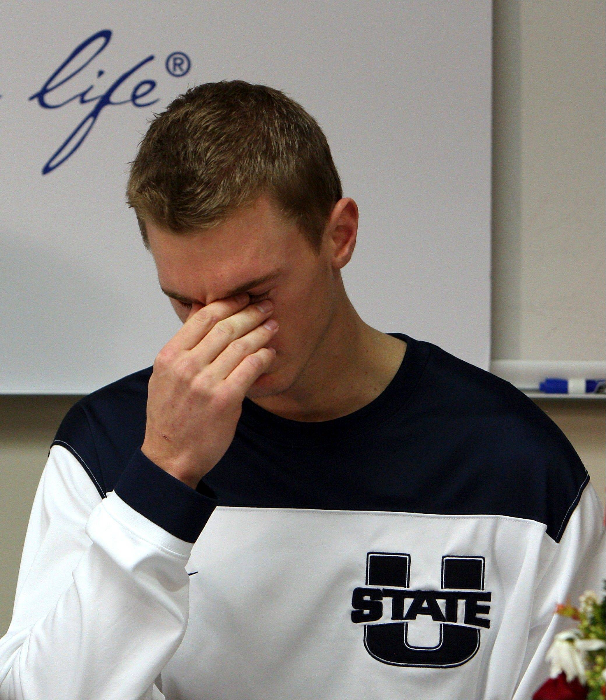 Utah State basketball player Danny Berger becomes emotional as he speaks with reporters about his recovery at Intermountain Medical Center in Murray, Utah. Berger collapsed during NCAA college basketball practice and went into cardiac arrest, resulting in a defibrillator being implanted in his chest.