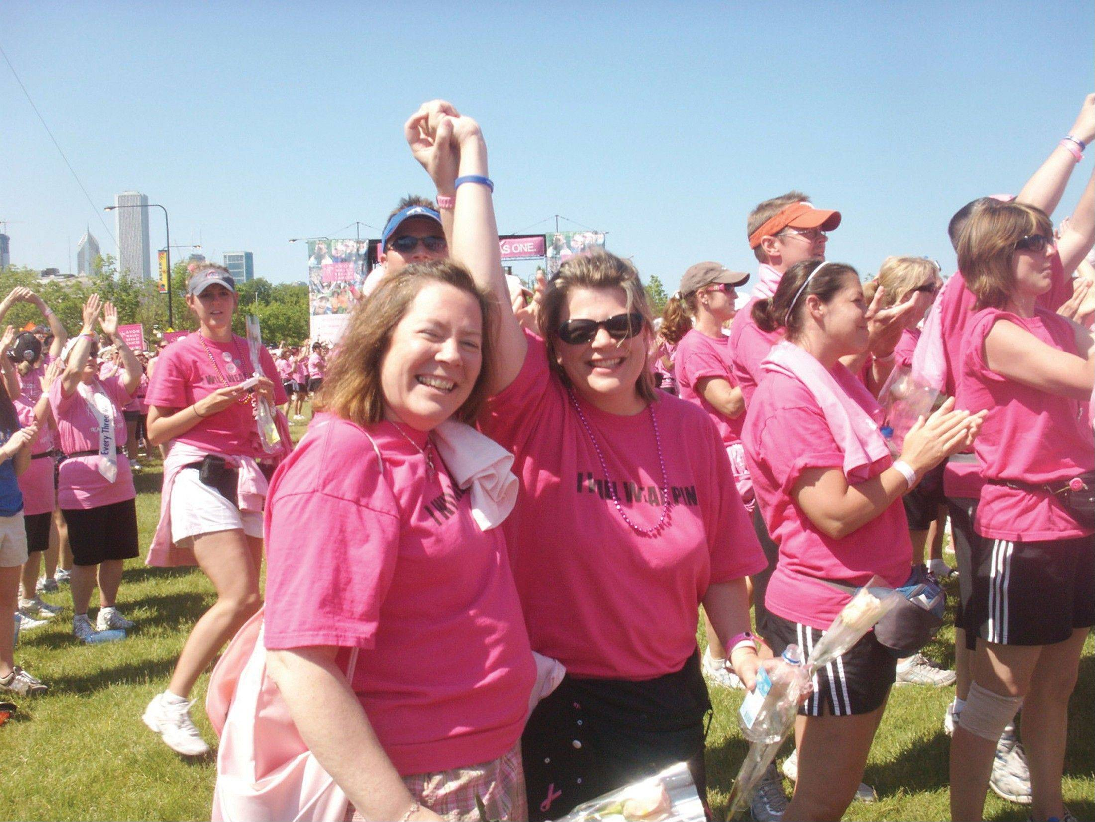 Sisters Kathleen Cecil, left, and Annie Gruber, with brother Eugene Powers behind, celebrate at the closing ceremonies of the Avon Walk for Breast Cancer in June 2009. Family members formed team Team KA-POW and have helped raise more than $650,000 in eight years for the Avon Walk. Kathleen lost her battle with breast cancer last spring, and Annie is still fighting the disease.