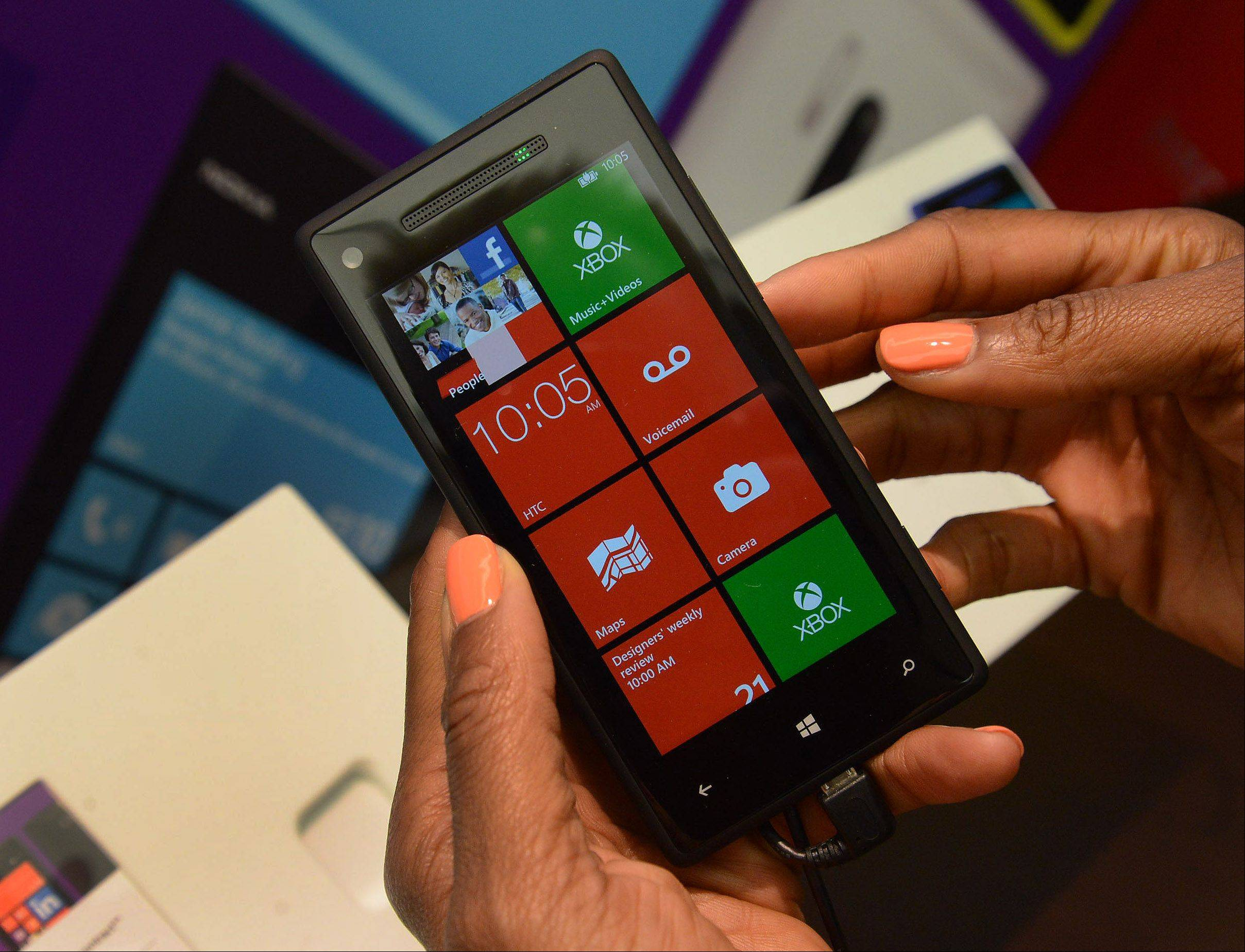 Store manager Lisa Seigneur shows how the Windows Nokia Lumia 920 works at the new Microsoft store inside Woodfield Mall.