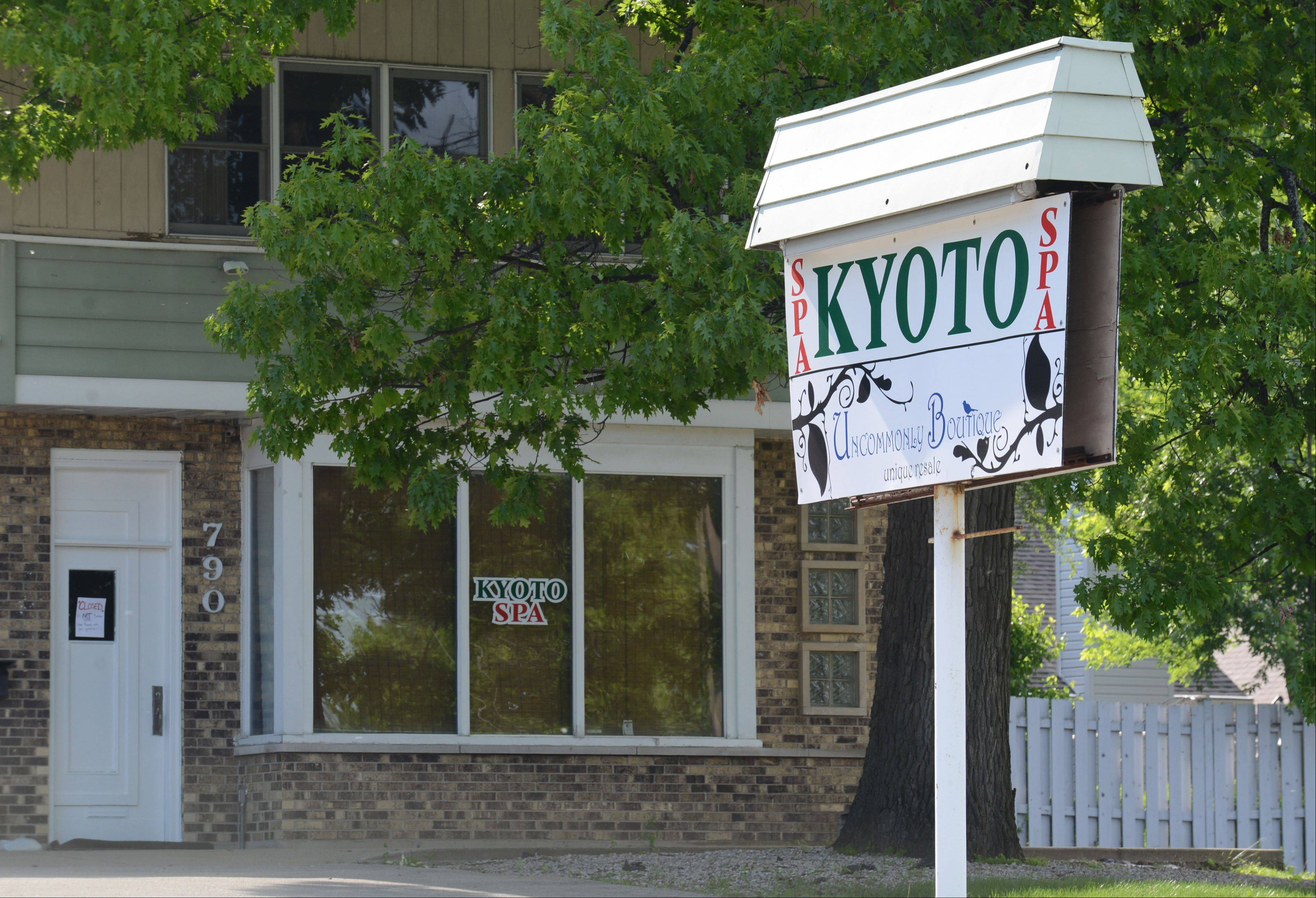 Grayslake has revoked the business license of Kyoto Spa and Massage on Route 83, where police say two women were charged with prostitution.