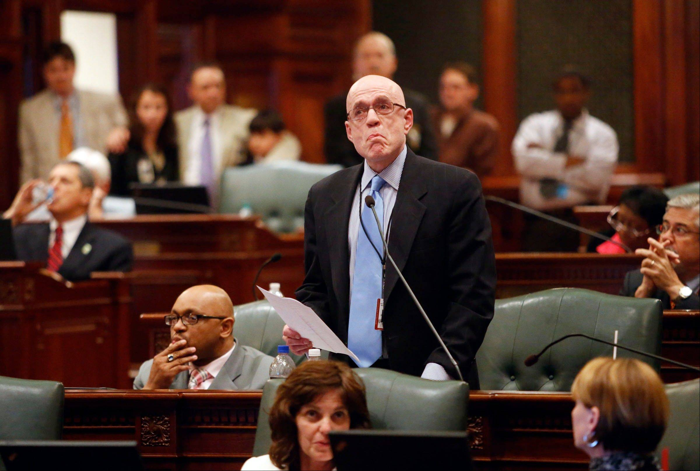 State Rep. Greg Harris, a Chicago Democrat, pauses to regain his composure as the gallery erupts in protest Friday after he announced he wouldn't call the gay marriage bill on the House floor.