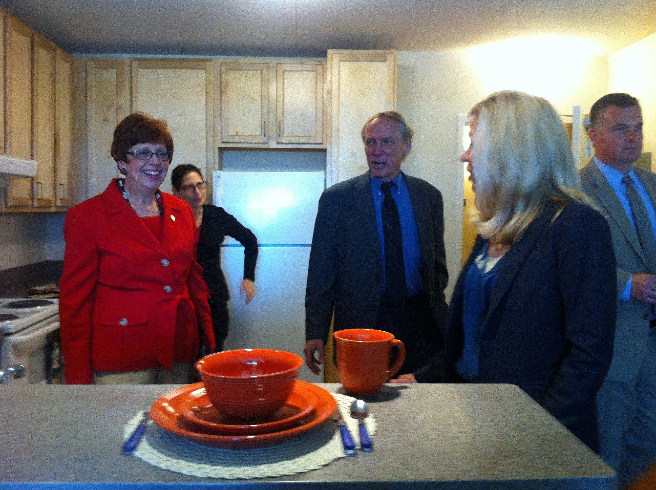 Mount Prospect Mayor Arlene Juracek, left, tours a kitchen.